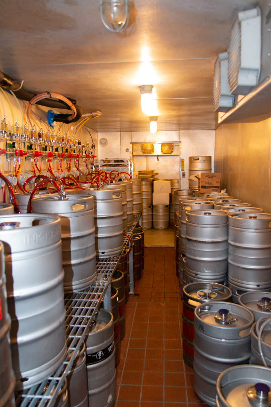 <p>All of the kegs at Big Ash are stored in the back of the brewery in a walk-in cooler. Chilled beer lines carry them all the way to the front tap room. / Image: Elizabeth A. Lowry // Published: 9.25.19</p>