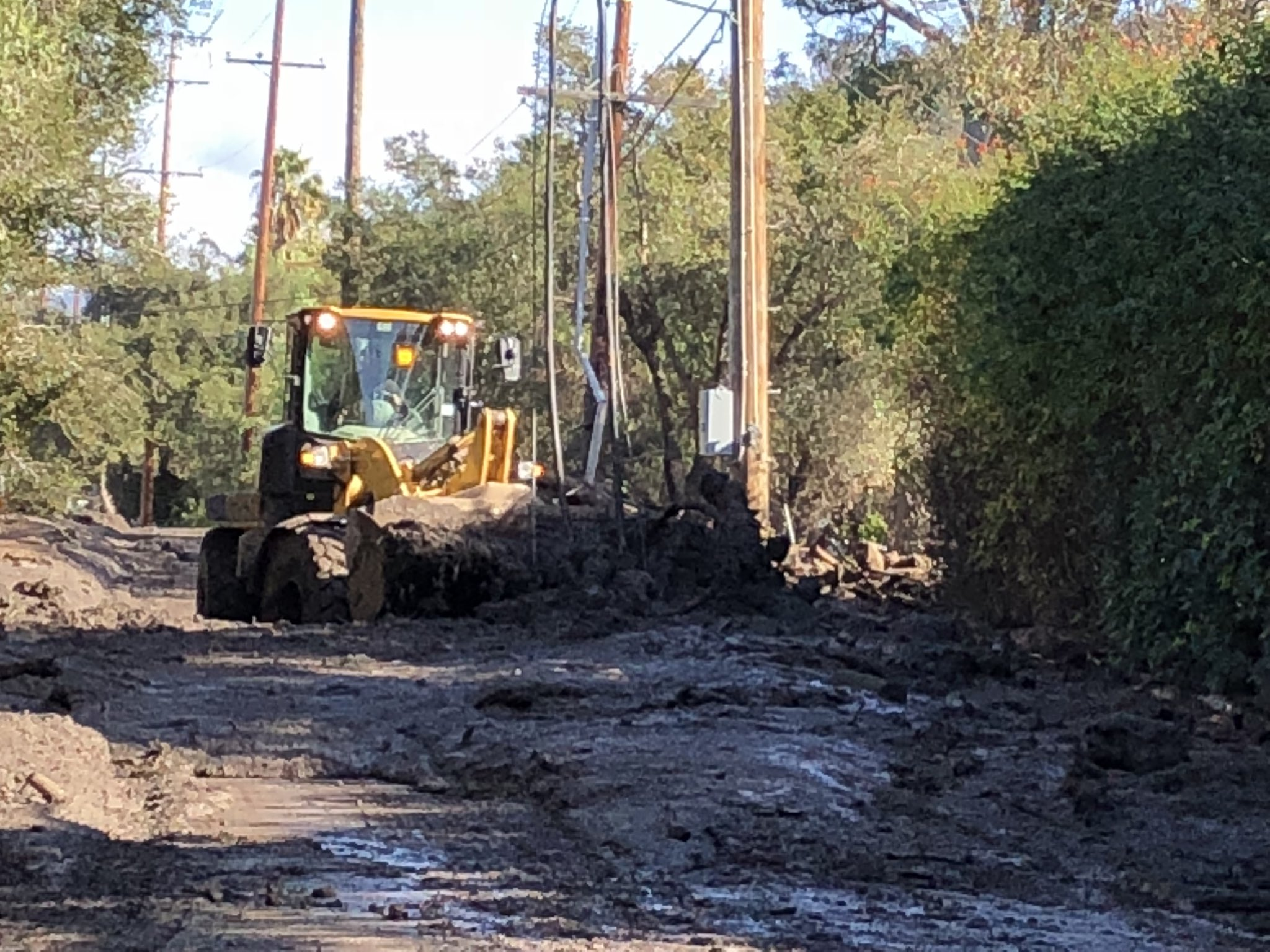 Large amounts of mud and debris are cleared from East Valley Road in Montecito. (Photo & Caption: Mike Eliason, Santa Barbara County Fire Dept.)
