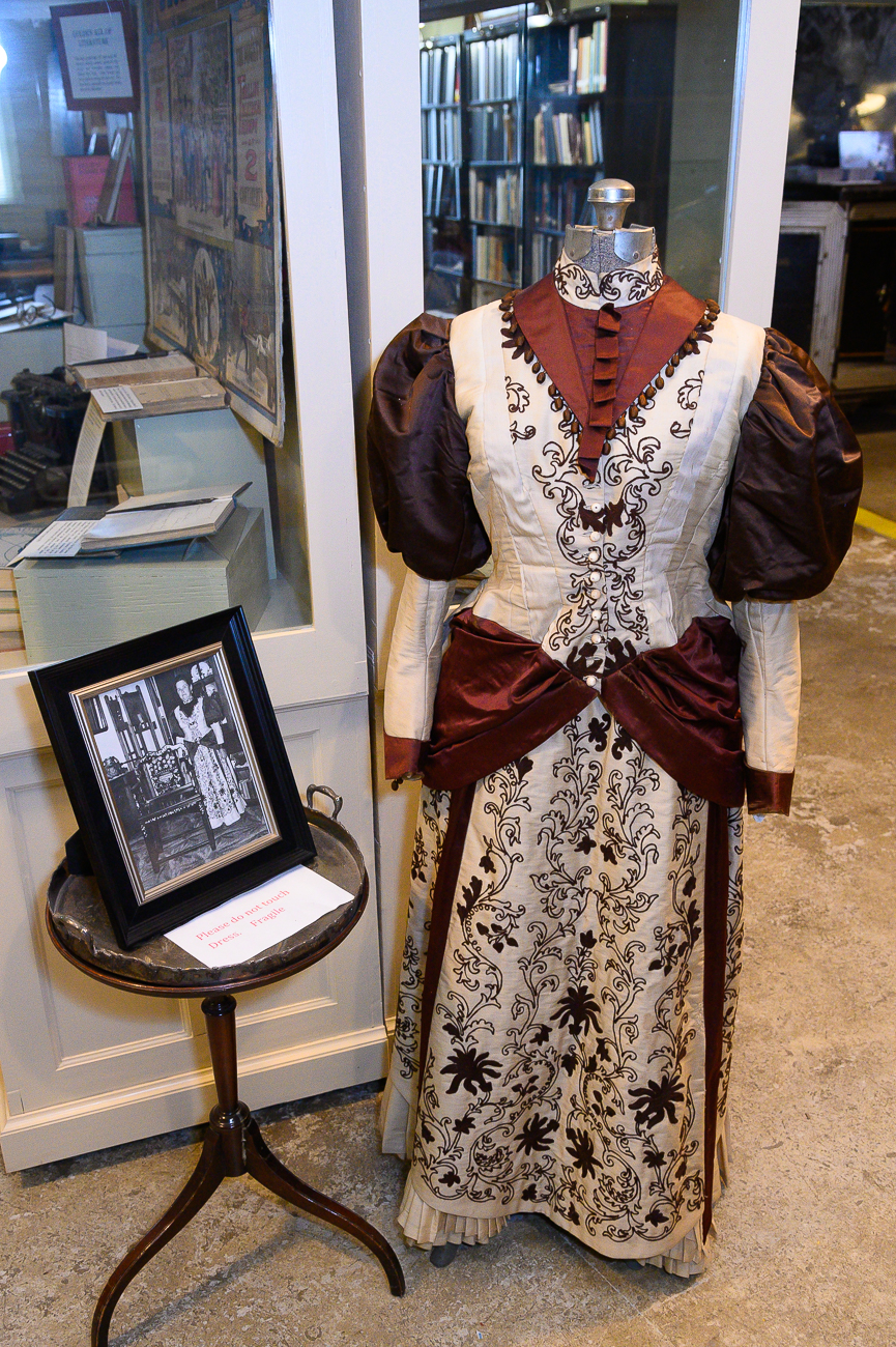 A dress with an old photo of its owner are on display. / Image: Phil Armstrong, Cincinnati Refined // Published: 1.7.20