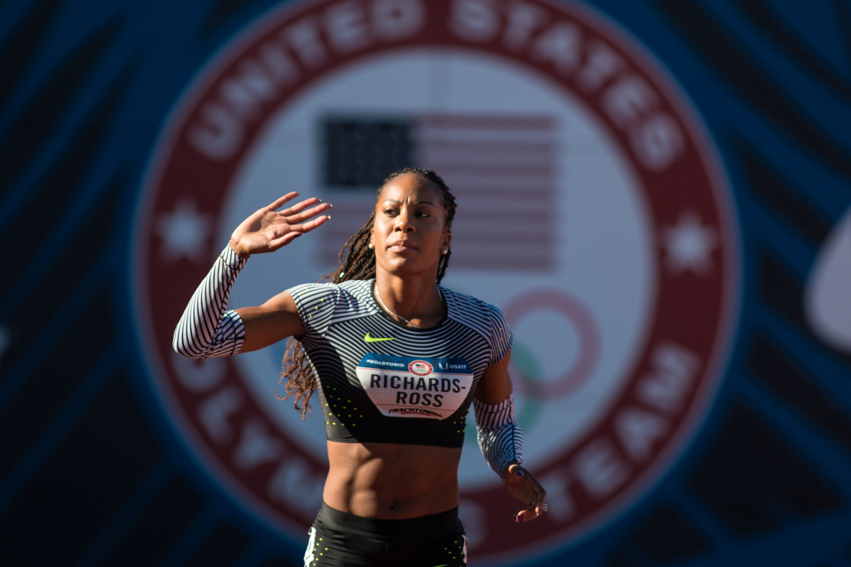 Nike�s Sanya Richards-Ross waves to the crowd after pulling up in the middle of the women�s 400m. Photo by Dillon Vibes