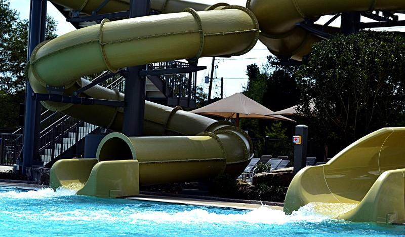 Outdoor pool with two water slides.