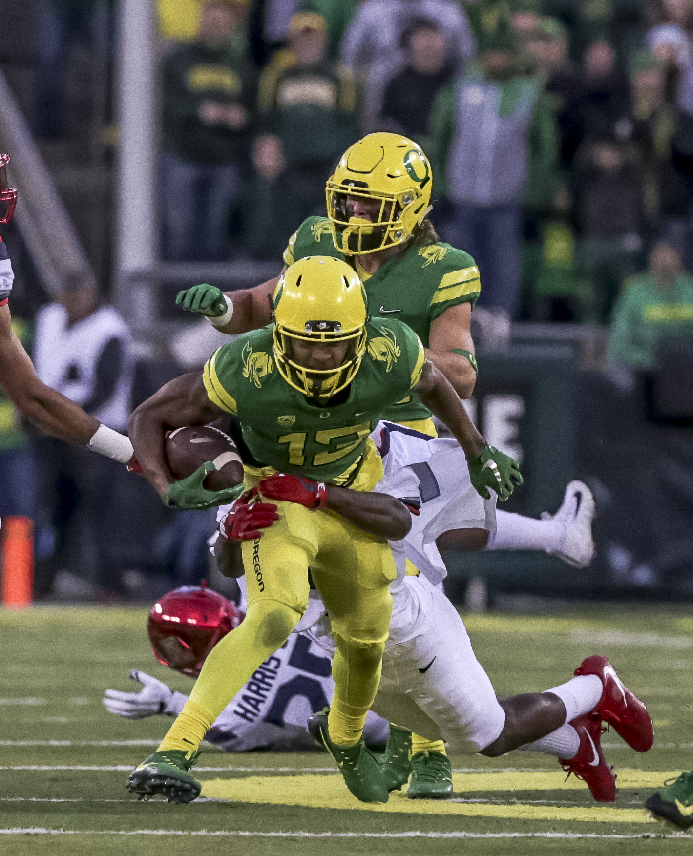 Oregon wide receiver Dillon Mitchell (#13) charges ahead to gain yardage. The Oregon Ducks lead the Arizona Wildcats 28 to 21 at the end of the first half at Autzen Stadium on Saturday, November 18, 2017. Photo by Ben Lonergan, Oregon News Lab
