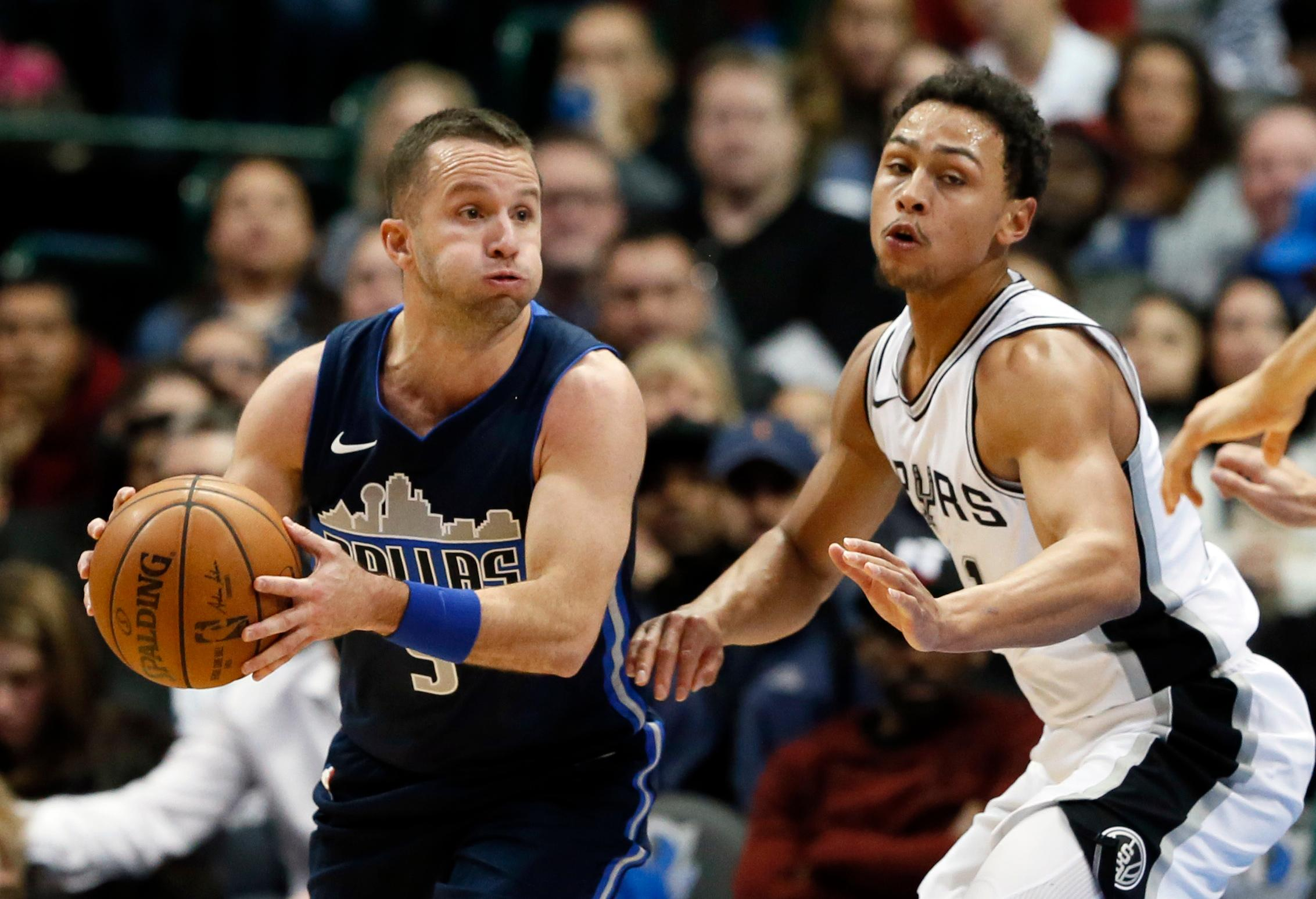 Dallas Mavericks guard J.J. Barea (5) of Puerto Rico looks to make a pass as San Antonio Spurs' Bryn Forbes (11) defends in the second half of an NBA basketball game, Tuesday, Dec. 12, 2017, in Dallas. The Mavericks won, 95-89. (AP Photo/Tony Gutierrez)