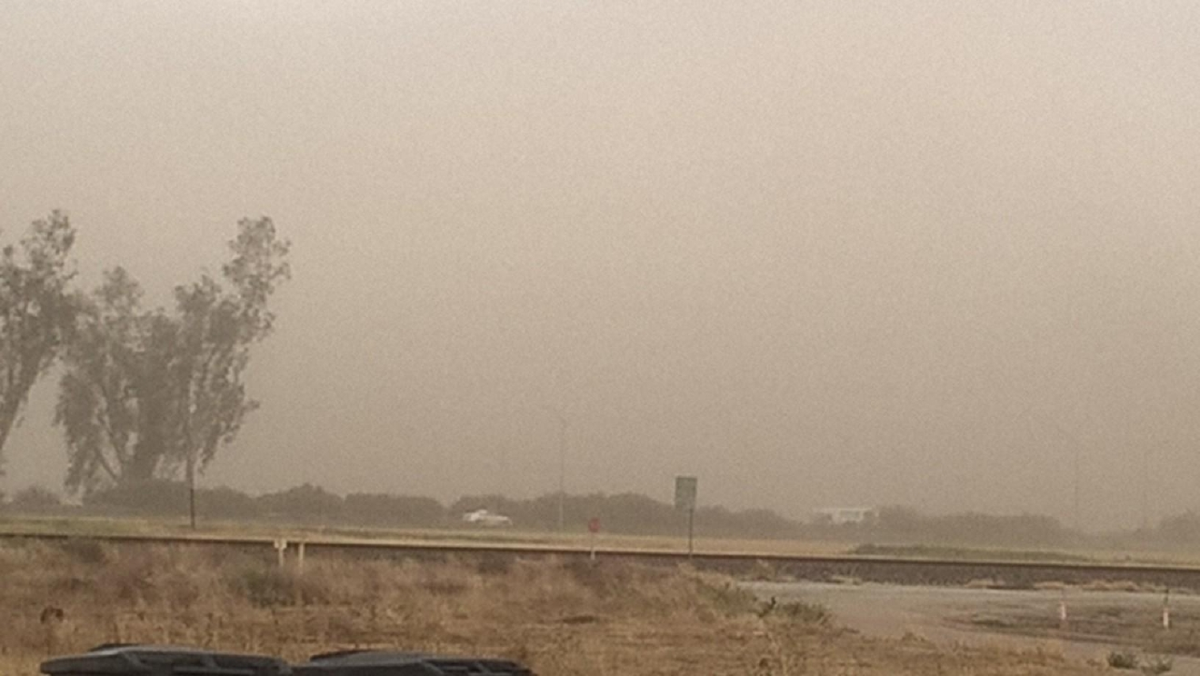 Photo courtesy: Brian Herrin in Tipton (dust storm).