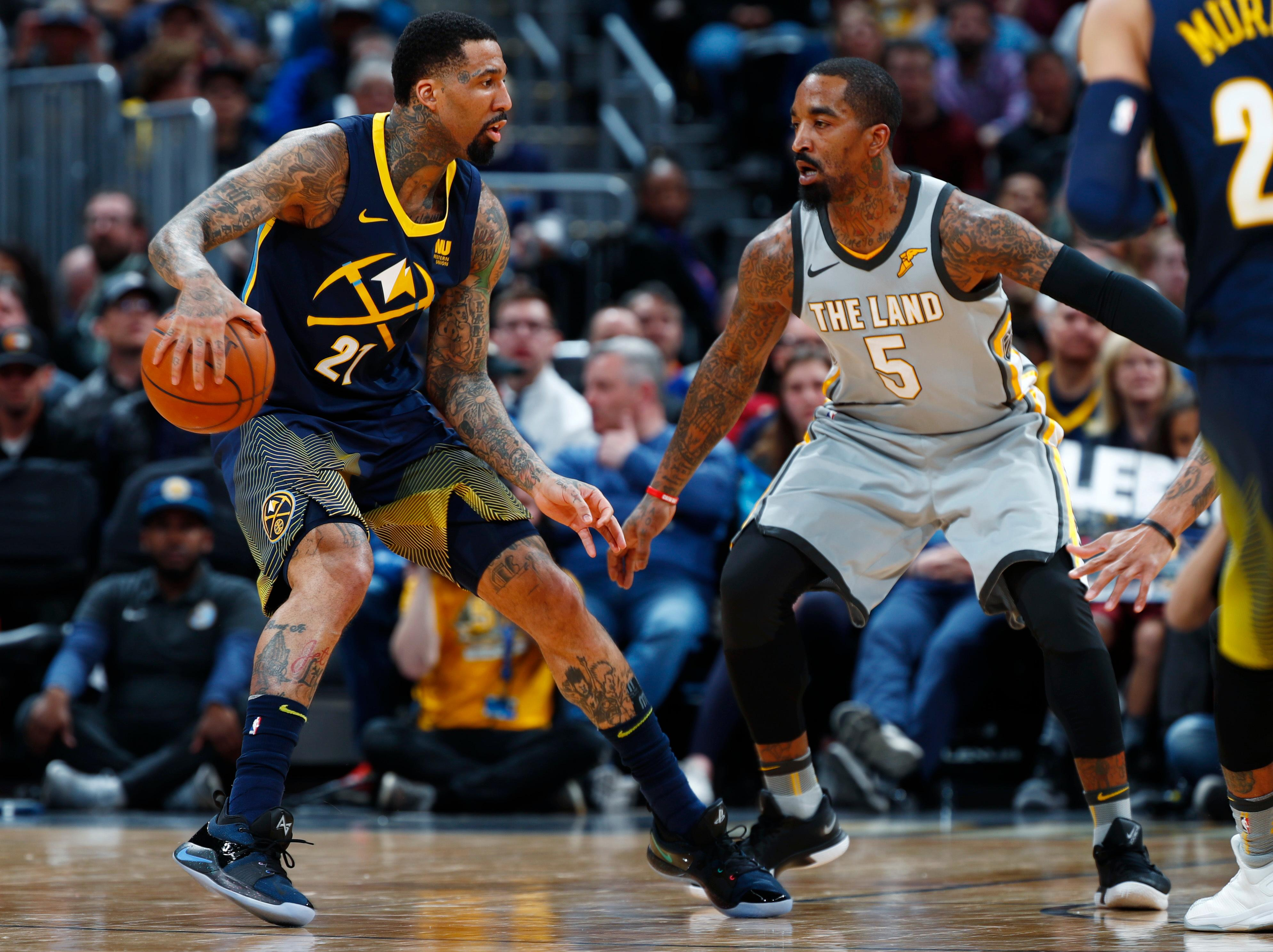 Denver Nuggets forward Wilson Chandler, left, looks to drive to the basket as Cleveland Cavaliers guard JR Smith defends during the first half of an NBA basketball game Wednesday, March 7, 2018, in Denver. (AP Photo/David Zalubowski)