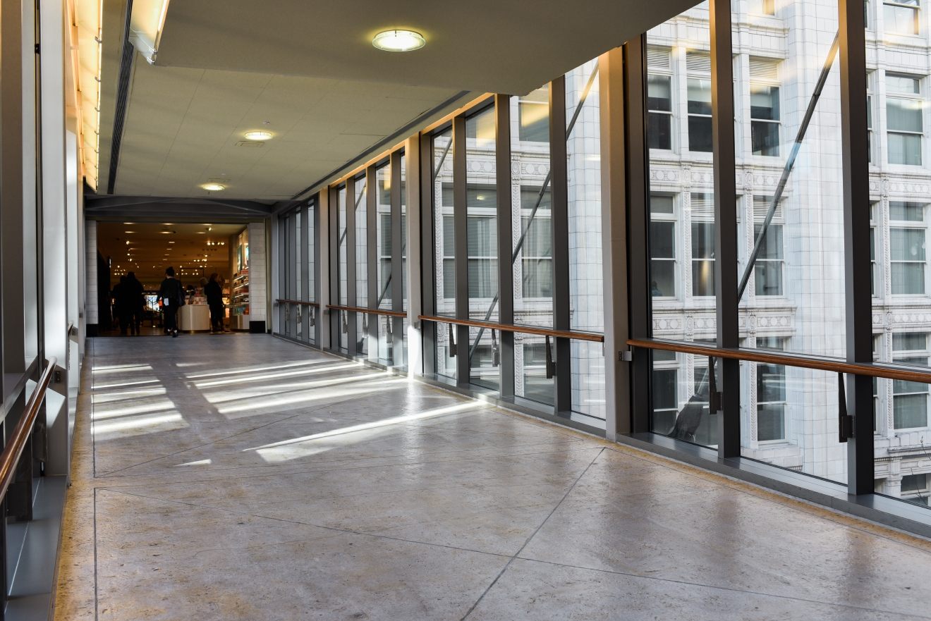 One of the most photographed skybridge in Seattle has to be the one that links Pacific Place to the downtown Nordstrom location. The view of the city from the center of the skybridge is magical. Built in 1988, the skybridge has been an important part of the shopping experience between the two buildings. (Image: Rebecca Mongrain/Seattle Refined)