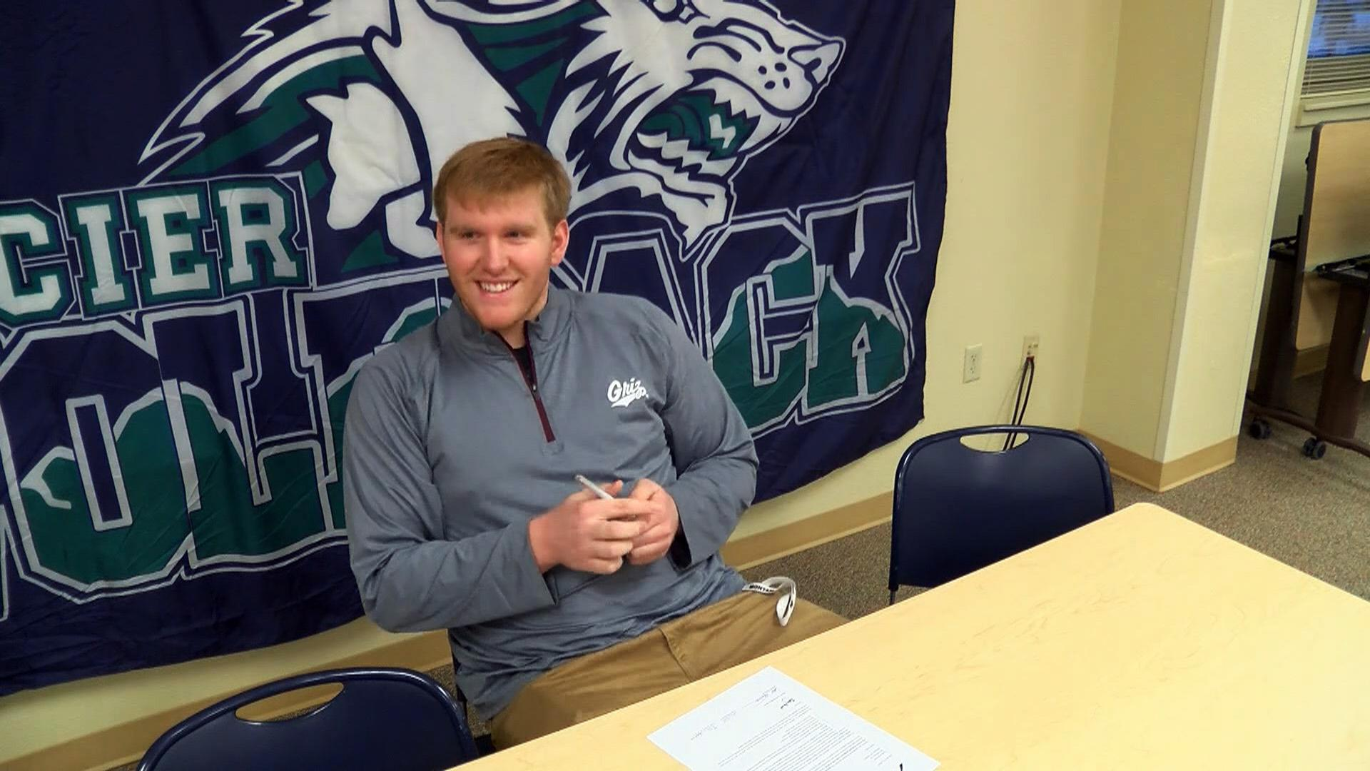 Hartsoch smiles during an event recognizing him signing his letter of intent to play football for the Montana Grizzlies.<p></p>