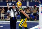 An official signals touchdown after Green Bay Packers wide receiver Jordy Nelson (87) caught a pass for the score against the Dallas Cowboys in the second half, Sunday, Oct. 8, 2017, in Arlington, Texas.