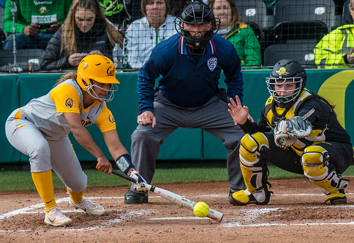 Cal Bears Khala Taylor (#33) takes a low swing. The Oregon Ducks defeated the Cal Bears 2-1 in game two of a three-game series. Photo by Rhianna Gelhart, Oregon News Lab