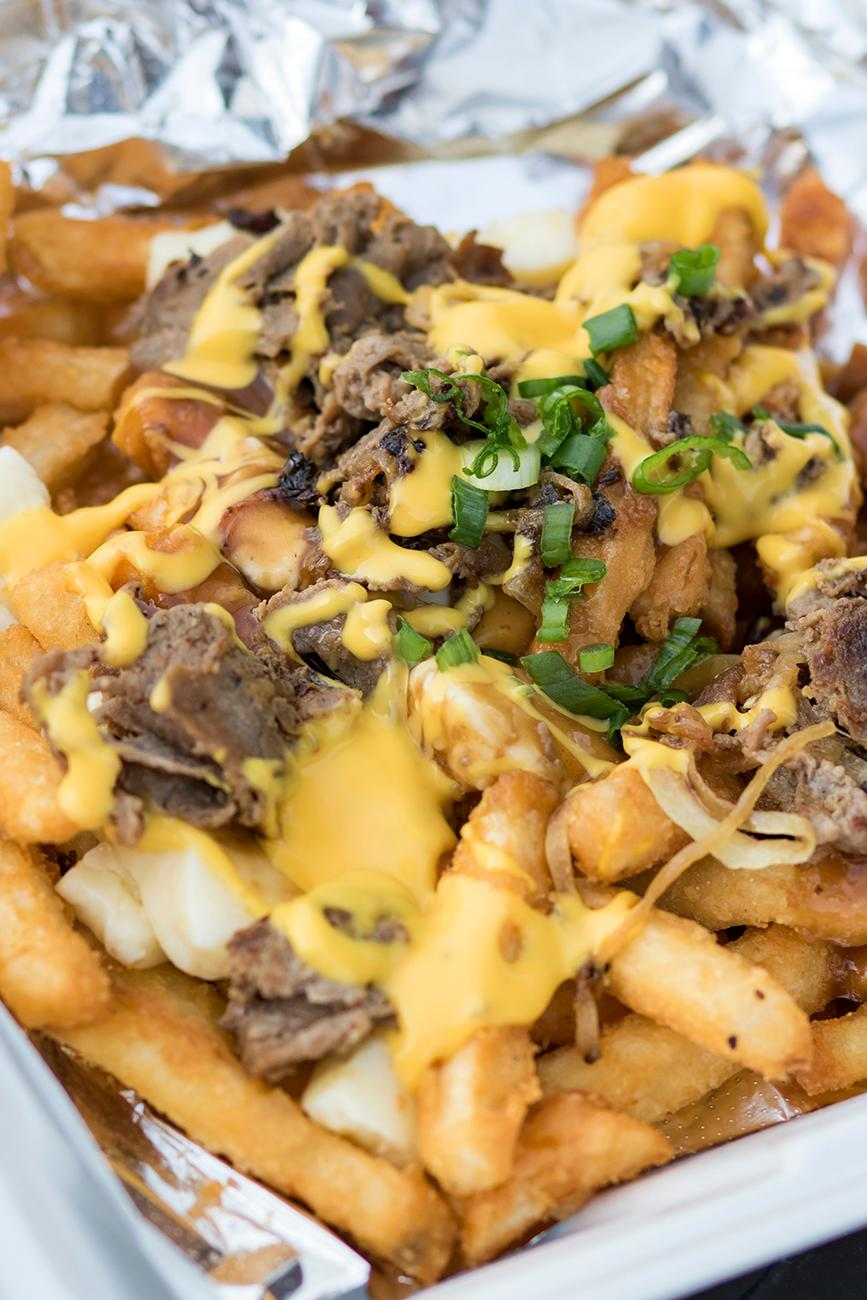 Philly poutine: french fries, cheese curds, beef gravy, sautéed sirloin, onions, peppers, and topped with cheese sauce / Image: Allison McAdams // Published: 5.11.19