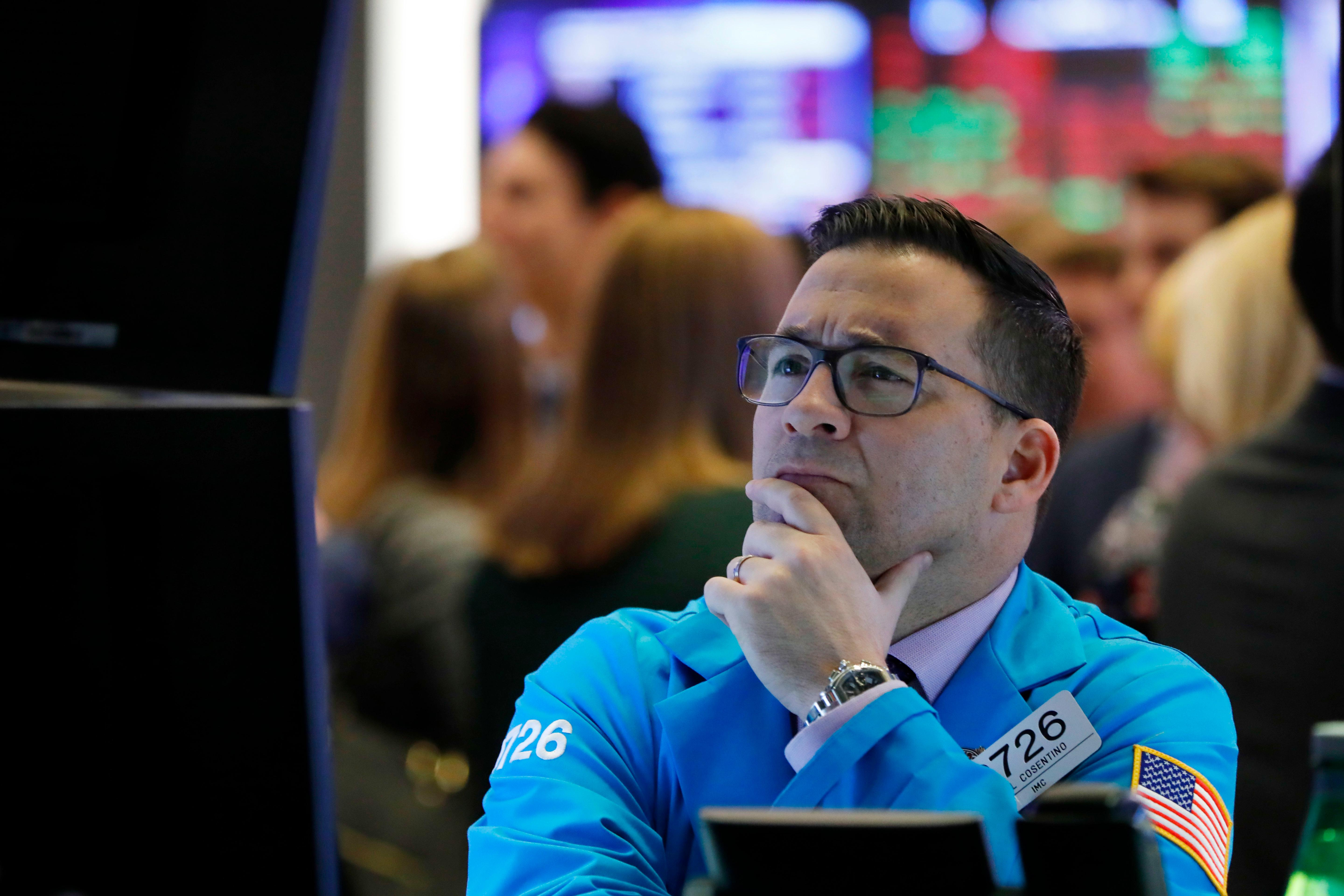 Specialist Paul Cosentino works on the floor of the New York Stock Exchange, Thursday, Jan. 10. (AP Photo/Richard Drew)