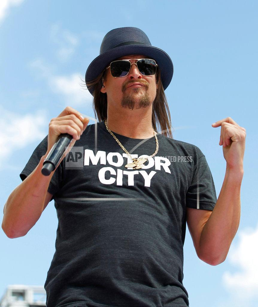 FILE - In this Feb. 22, 2015 file photo, Kid Rock performs before the Daytona 500 NASCAR Sprint Cup series auto race at Daytona International Speedway in Daytona Beach, Fla. The musician from suburban Detroit is teasing his potential 2018 U.S. Senate candidacy, though it is news to Michigan Republicans. Kid Rock, who was born Robert Ritchie, said Wednesday, July 12, 2017, that a website hinting at his campaign —www.kidrockforsenate.com — is legit. (AP Photo/Terry Renna, File)