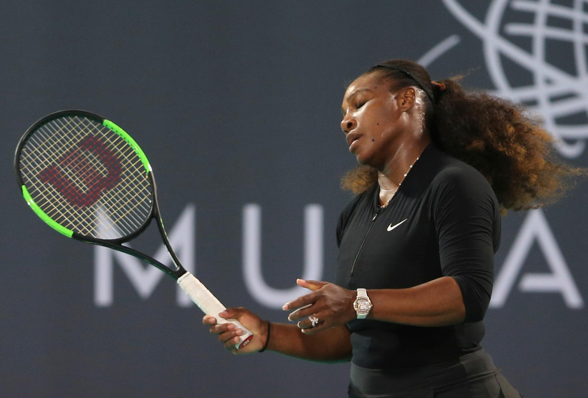 Serena Williams, of the U.S., reacts in an exhibition match against Jelena Ostapenko, of Latvia, during the final day of the Mubadala World Tennis Championship in Abu Dhabi, United Arab Emirates, Saturday, Dec. 30, 2017. (AP Photo/Kamran Jebreili)