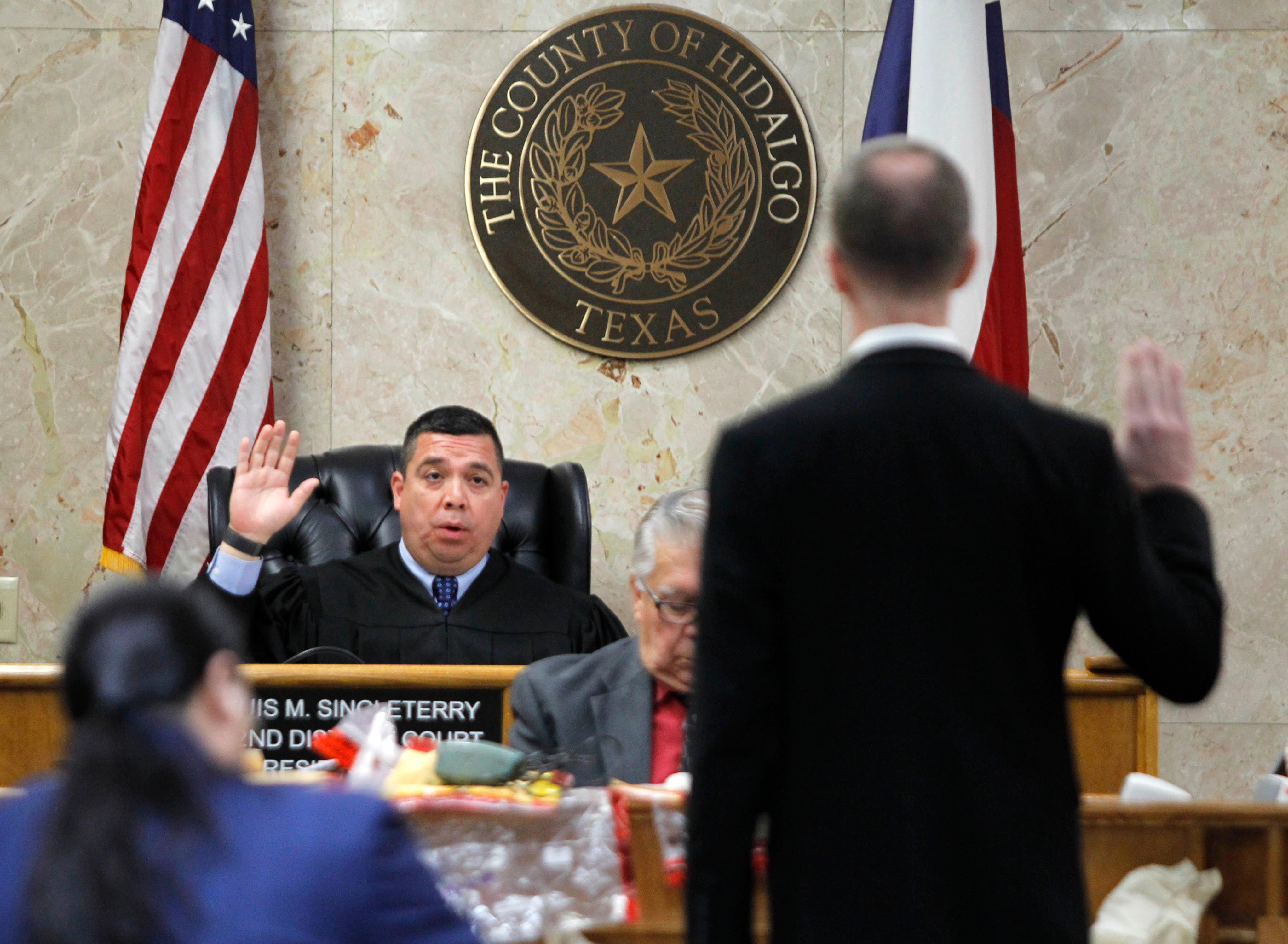 92nd state District Judge Luis Singleterry swears in Brooks Egerton during John Bernard Feit's trial for the 1960 murder of Irene Garza Tuesday, December 5, 2017, at the Hidalgo County Courthouse in Edinburg. Egerton is a former reporter of the Dallas Morning News who interviewed Rev. Joseph O'Brien about Feit's involvement in the murder of Garza.  (Nathan Lambrecht/The Monitor/Pool)