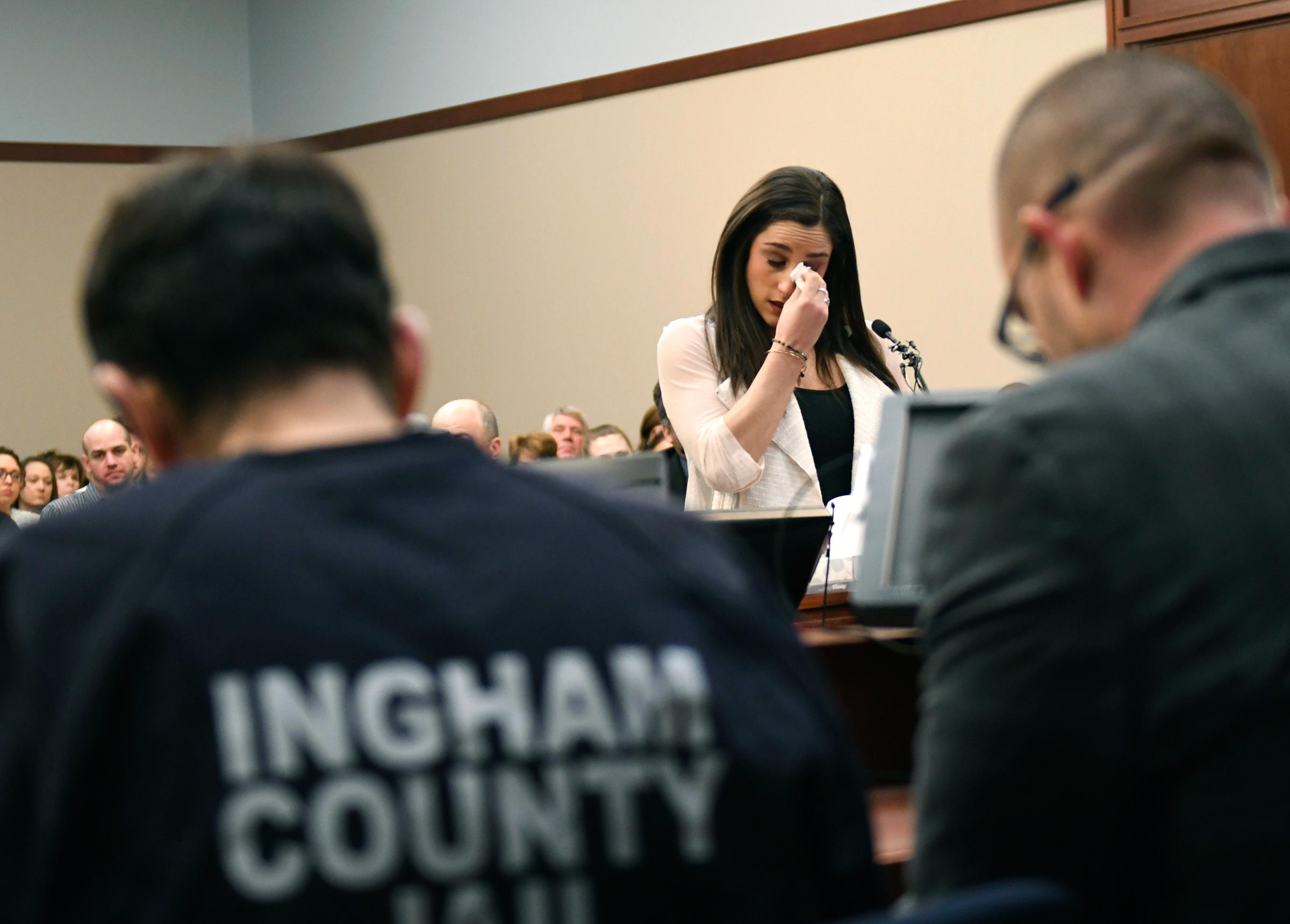 Jordyn Wieber gives her victim impact statement in Circuit Judge Rosemarie Aquilina's courtroom during the fourth day of sentencing for former sports doctor Larry Nassar, who pled guilty to multiple counts of sexual assault, Friday, Jan. 19, 2018, in Lansing, Mich. (Matthew Dae Smith /Lansing State Journal via AP)