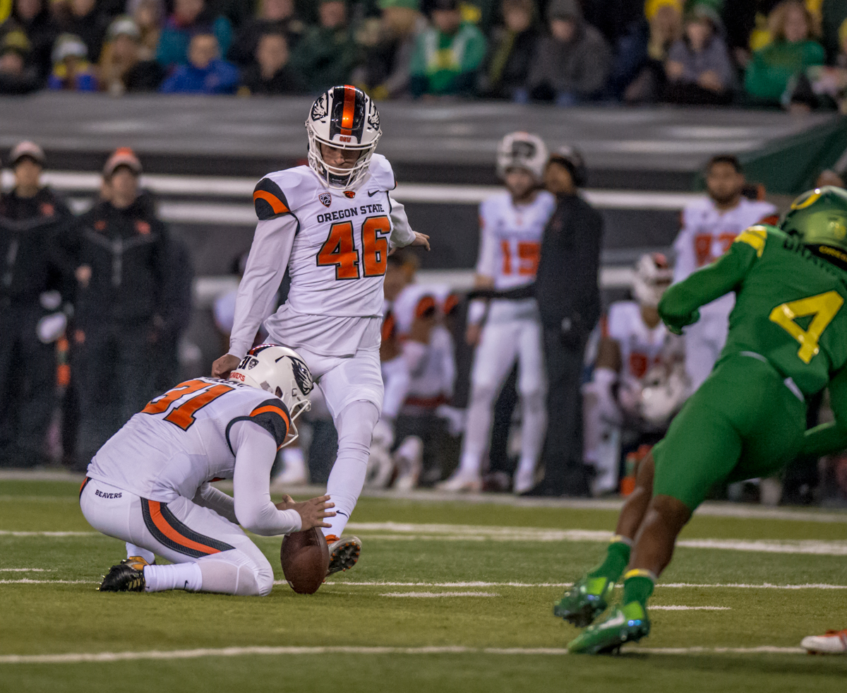 Oregon State place kicker  Jordan Choukair (#46) kicks a field goal. The Oregon Ducks defeated the Oregon State Beavers 69 to 10 in the 121st Civil War game at Autzen Stadium in Eugene, Ore. on Saturday November 25, 2017. Photo by Ben Lonergan, Oregon News Lab