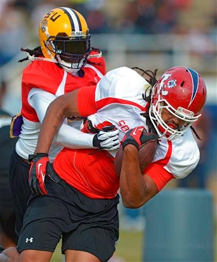 South Squad safety Craig Loston of LSU (6) wraps up South Squad tight end Marcel Jensen of Fresno State (85) during Senior Bowl practice at Fairhope Municipal Stadium, Monday, Jan. 20, 2014 in Fairhope, Ala.
