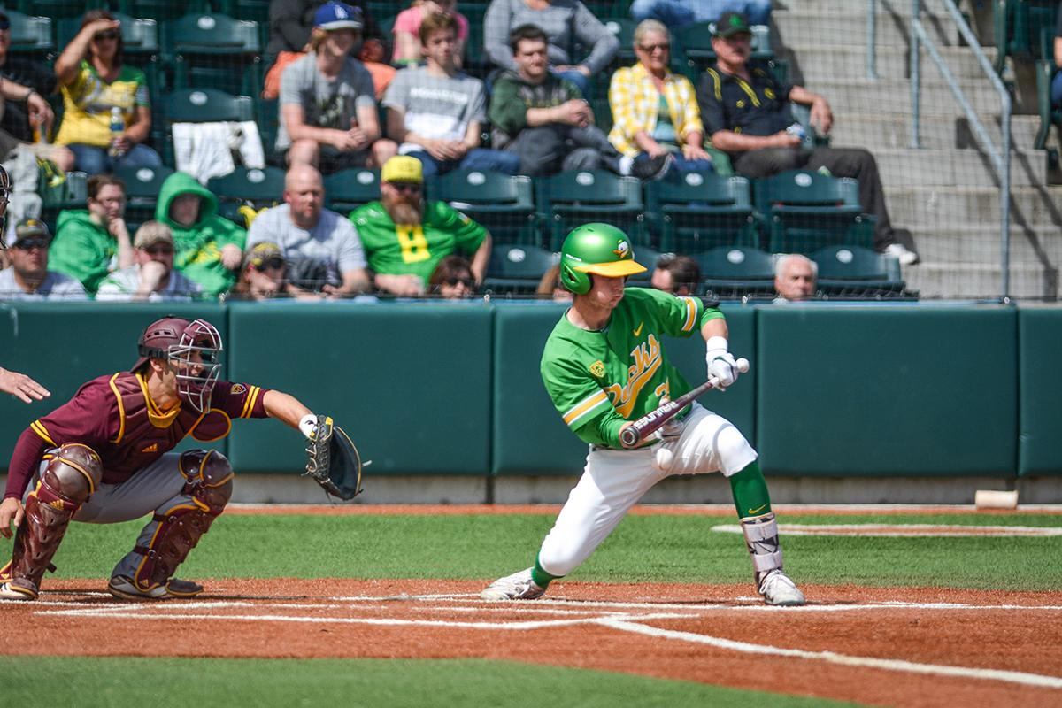 Ducks infielder Ryne Nelson (#29) lays down a bunt to try and get on base. Despite a late comeback, the Ducks fall to Arizona State Sun Devils 4-3 in the second game of a three-game series. Photo by Jacob Smith, Oregon News Lab