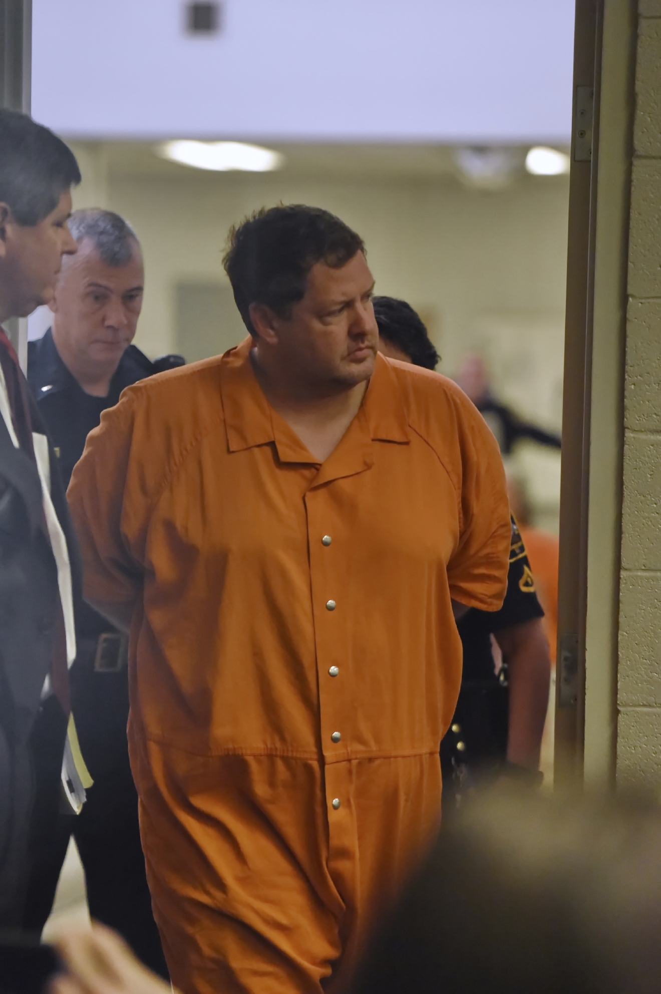 Todd Kohlhepp's enters the courtroom of Judge Jimmy Henson for a bond hearing at the Spartanburg Detention Facility, in Spartanburg, S.C. Sunday, Nov. 6, 2016.  (AP Photo/Richard Shiro)
