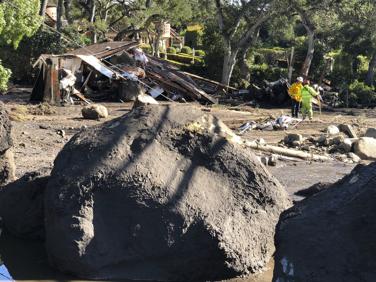 In this photo provided by Santa Barbara County Fire Department, shows destroyed homes dot the landscape along San Ysidro Creek near East Valley Road in Montecito, Calif. on Wednesday, Jan. 10, 2018. Runoff from heavy rain early Tuesday brought boulders, mudflow, and debris. (Mike Eliason/Santa Barbara County Fire Department via AP)
