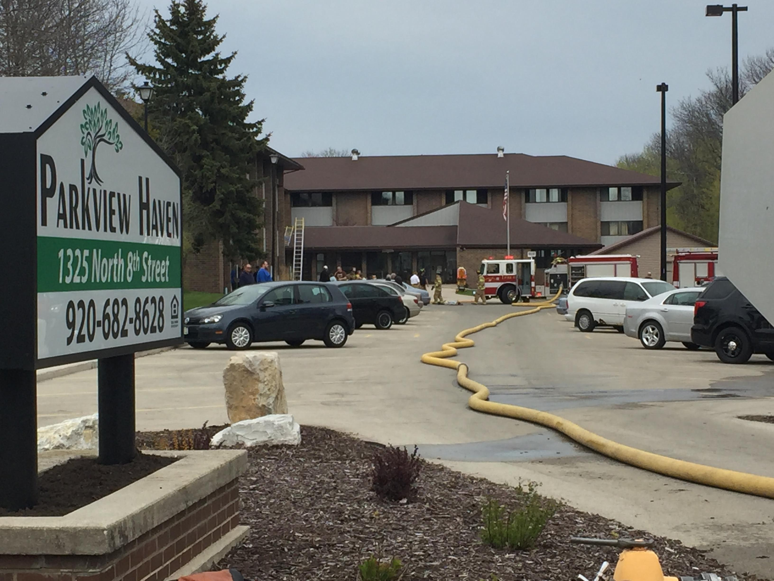 The scene of a fire at Park View Haven Apartments in Manitowoc, May 10, 2017.  (WLUK/Doug Ritchay)