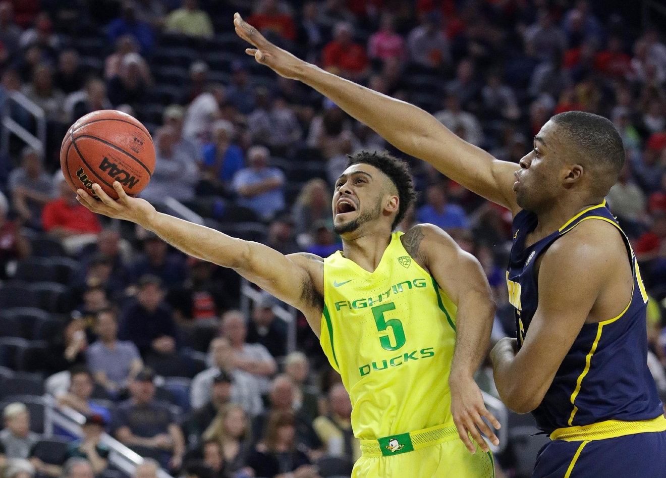 Oregon's Tyler Dorsey shoots around California's Kingsley Okoroh during the first half of an NCAA college basketball game in the semifinals of the Pac-12 tournament Friday, March 10, 2017, in Las Vegas. (AP Photo/John Locher)