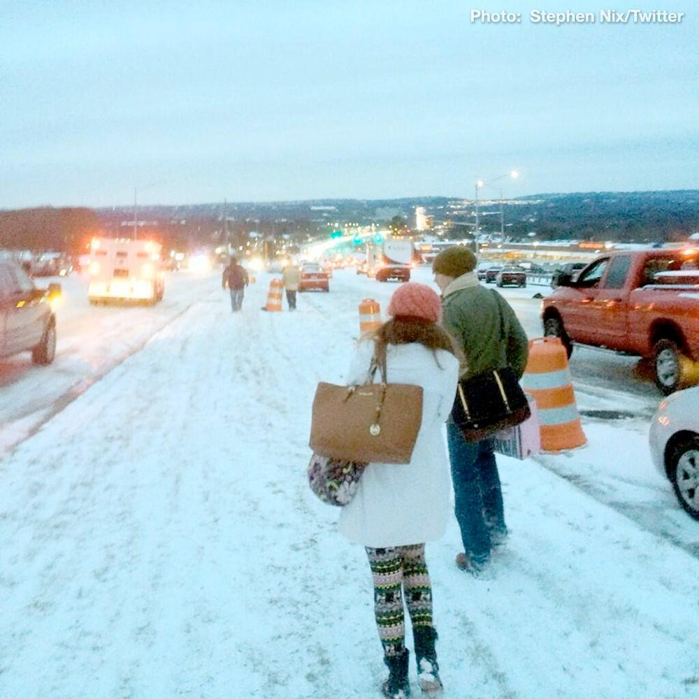 Stranded motorists on Highway 280 in Birmingham ditch their vehicles and walk to area shelters, Tuesday, January 28, 2014.