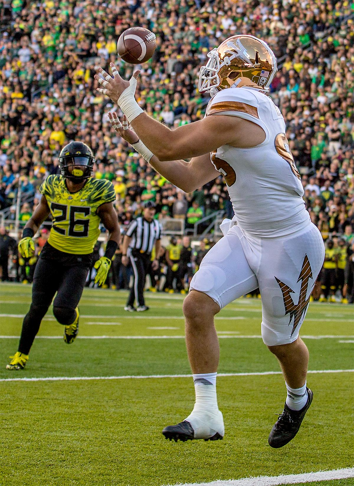 The Sun Devils' Kody Kohl (#83) makes a catch as he runs into the end zone to score a touchdown. The Oregon Ducks broke their losing streak by defeating the ASU Sun Devils on Saturday 54-35. Photo by August Frank, Oregon News Lab