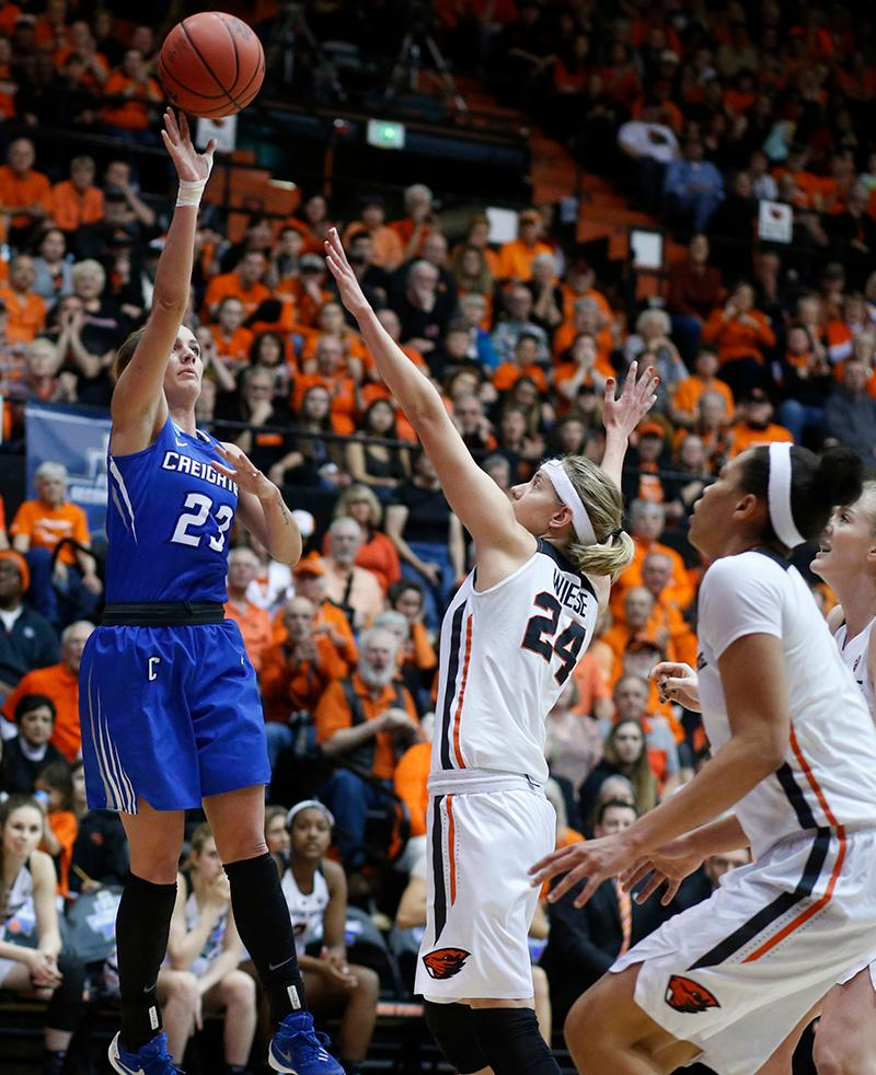 Creighton's Marissa Janning (23) shoots over Oregon State's Sydney Wiese (24) during the first half of a second-round game in the NCAA women's college basketball tournament Sunday, March 19, 2017, in Corvallis, Ore. (AP Photo/Timothy J. Gonzalez)