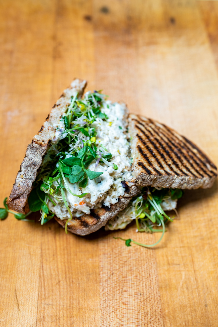 Fabulous Kimchicken: poached chicken breast, fab ferment and kimchi, house mayo, and sprouts on grilled white bread{ }/ Image: Amy Elisabeth Spasoff // Published: 9.29.18
