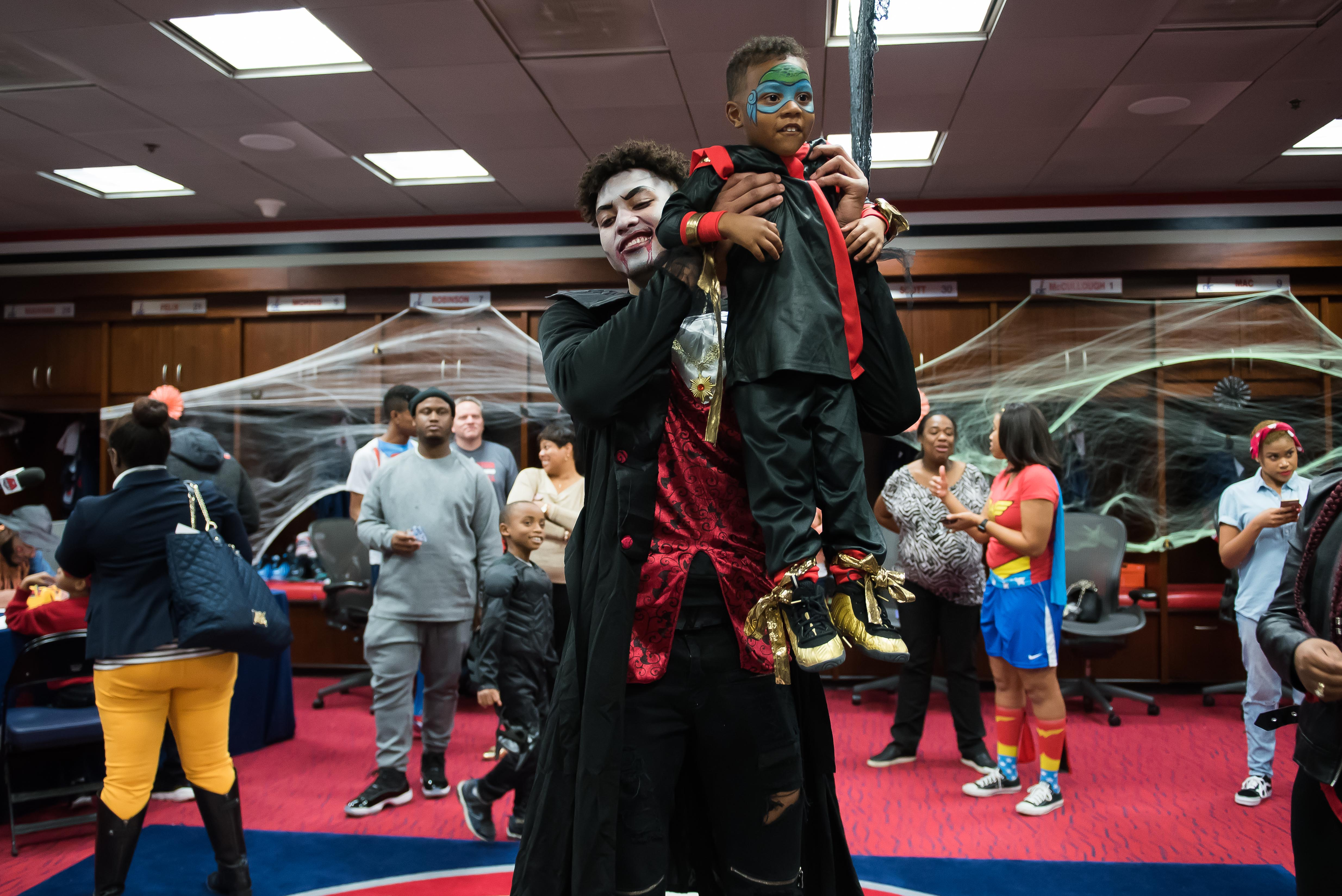 "Pumpkins and basketballs and Wizards ... OH MY! Washington Wizards players Kelly Oubre Jr. and Mike Scott hosted the team's annual Halloween party and it could not have been cuter! The kids, ages 6-12 from Dreams for Kids and the Wizards Kid's Club, got to ""trick or treat"" in the Wizards locker room as they showed off their best costumes. The Wizards Girls and G-Wiz joined the guys, who were dressed as characters from Goodnight Goon by Michael Rex and Pete the Cat: Trick or Pete by James Dean. Is it wrong to add this party to my ""list of reasons to have children?"" (Image: Joy Asico)"