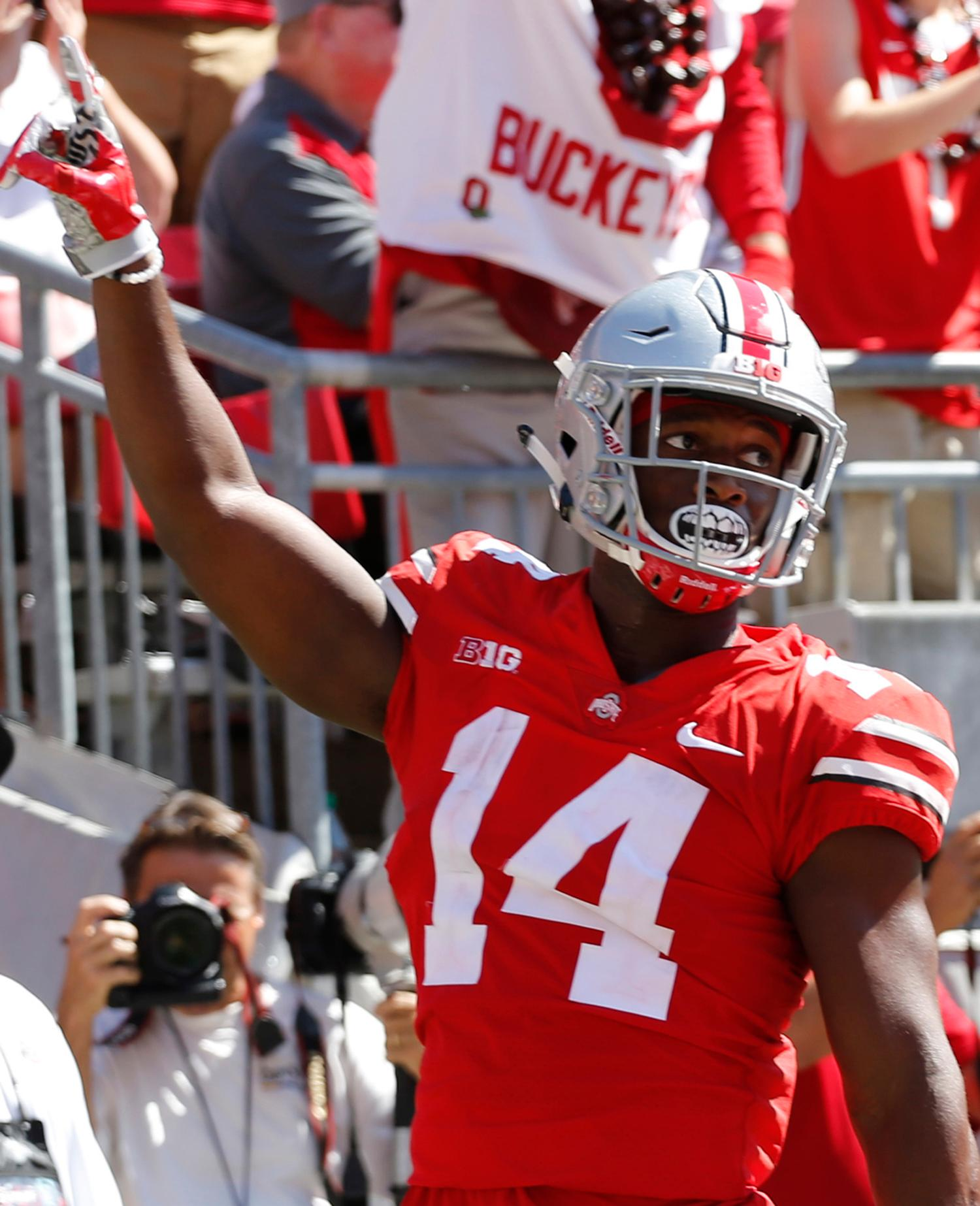 FILE - In this Sept. 23, 2017, file photo, Ohio State receiver K.J. Hill celebrates his touchdown against UNLV during the first half of an NCAA college football game, in Columbus, Ohio. Hill will be back with the Buckeyes next season. (AP Photo/Jay LaPrete, File)