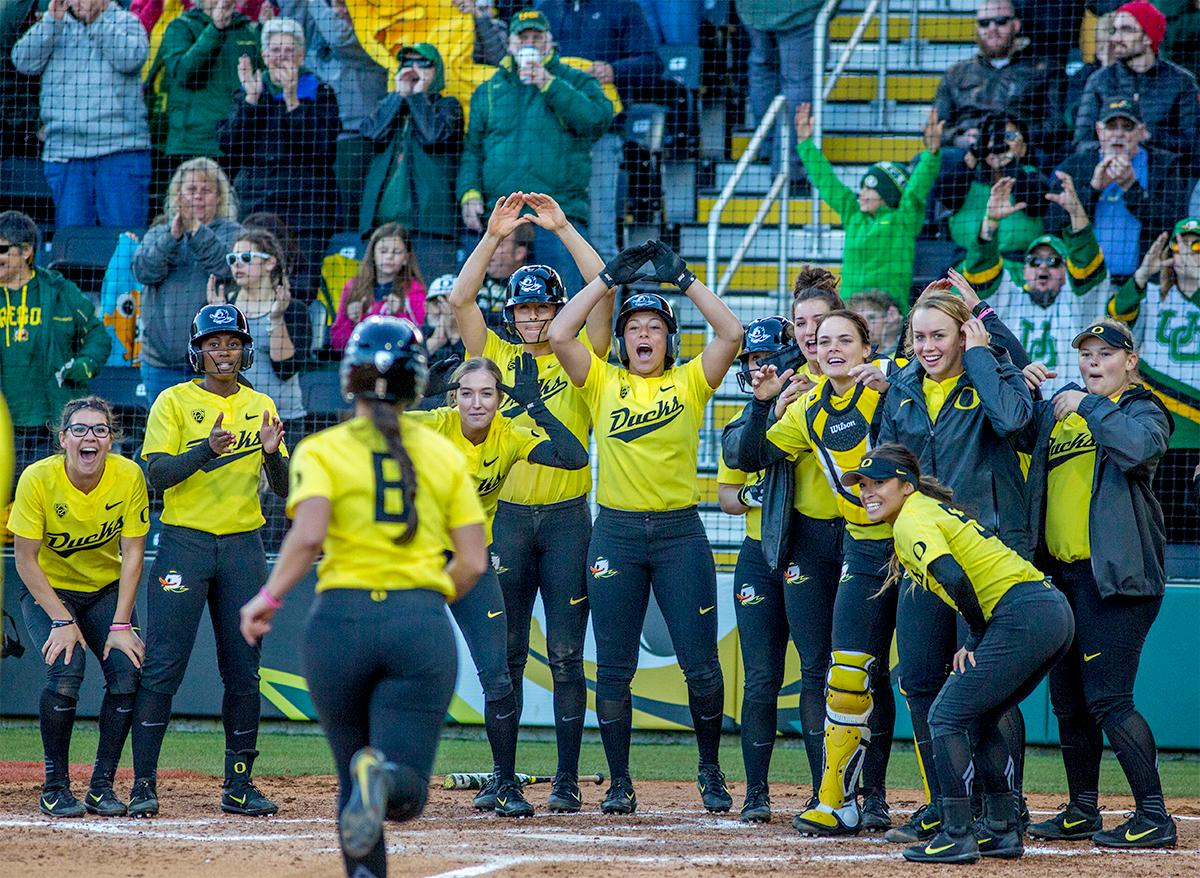 The Duck's Lauren Lindvall (#8) runs into home plate after Mia Camuso hits a home run to win the game. The Oregon Ducks defeated the Oregon State Beavers 8-0 in game one of the three-game Civil War series on Friday night at Jane Sanders Stadium. The game was 0-0 until Gwen Svekis (#21) hit a solo home run in the fourth inning. Mia Camuso hit a grand slam in the fifth inning, ending the game for the Ducks by mercy rule. With tonight's victory, the Ducks are 39-6 and 12-6 in Pac-12 play. Photo by August Frank, Oregon News Lab