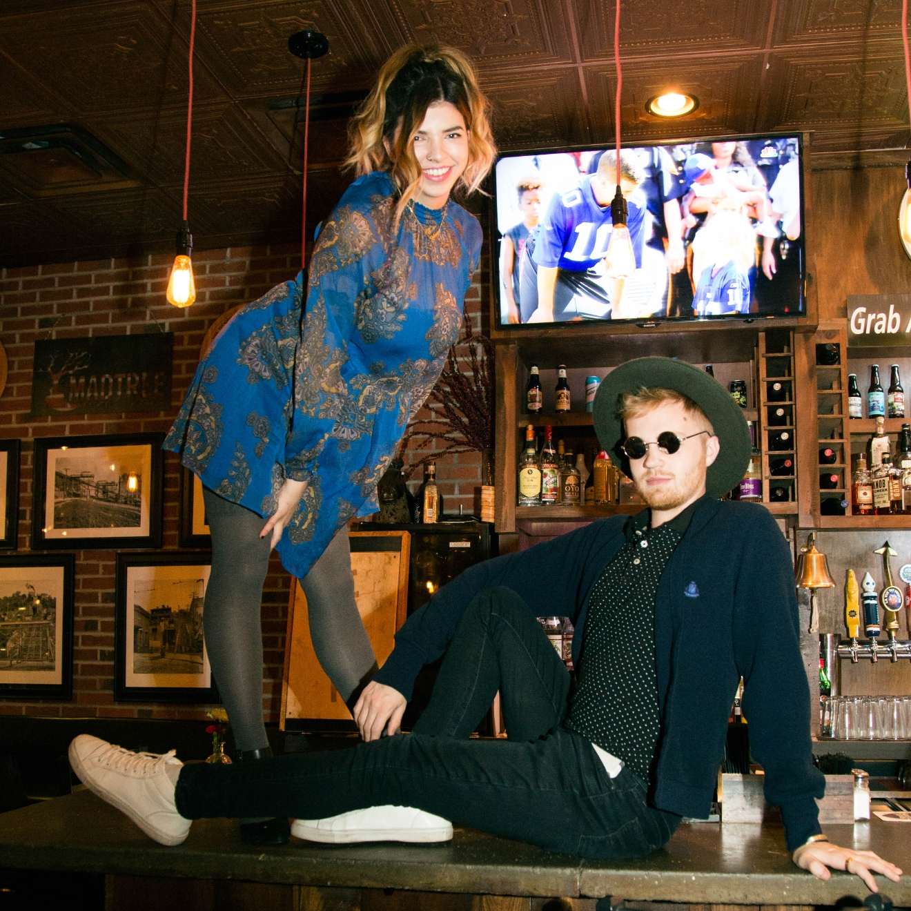 Becca Cowles in a Free People dress with accessories from etsy along with Garrett Douthitt in a hat from Zara, and outfit pieces from Izod, Levis, and Old Navy at Incline Public House. / Image: Catherine Viox // Published: 12.23.16