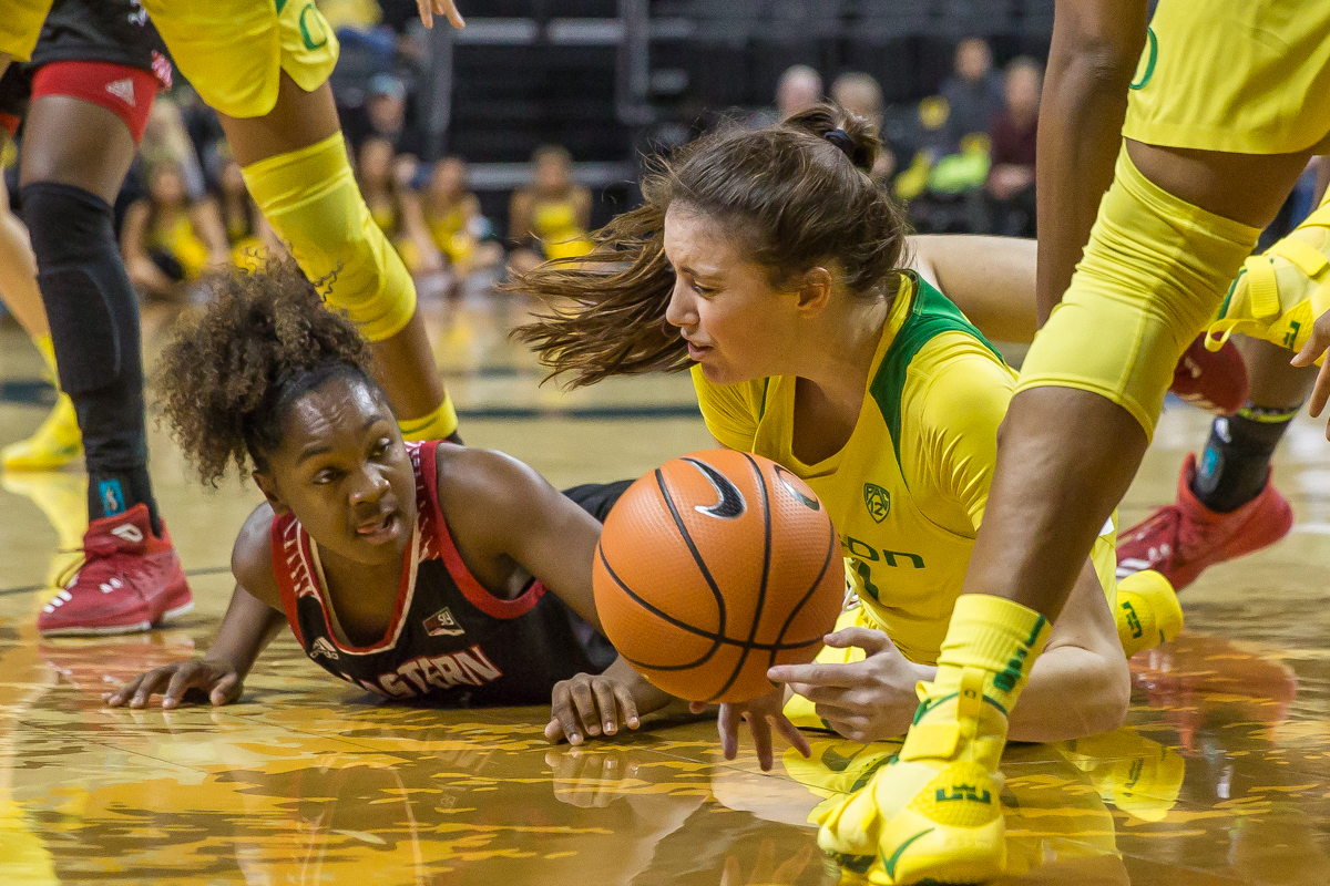 Oregon guard Aina Ayuso (#31) and Eastern Washginton guard Symone Starks (#3) stumble after the ball. The Oregon Ducks women's basketball team beat the Eastern Washington Eagles 81-40 Tuesday night. Ruthy Hebard led the Ducks with 22 points. Oregon is now 4-1 on the season. Photo by Dillon Vibes