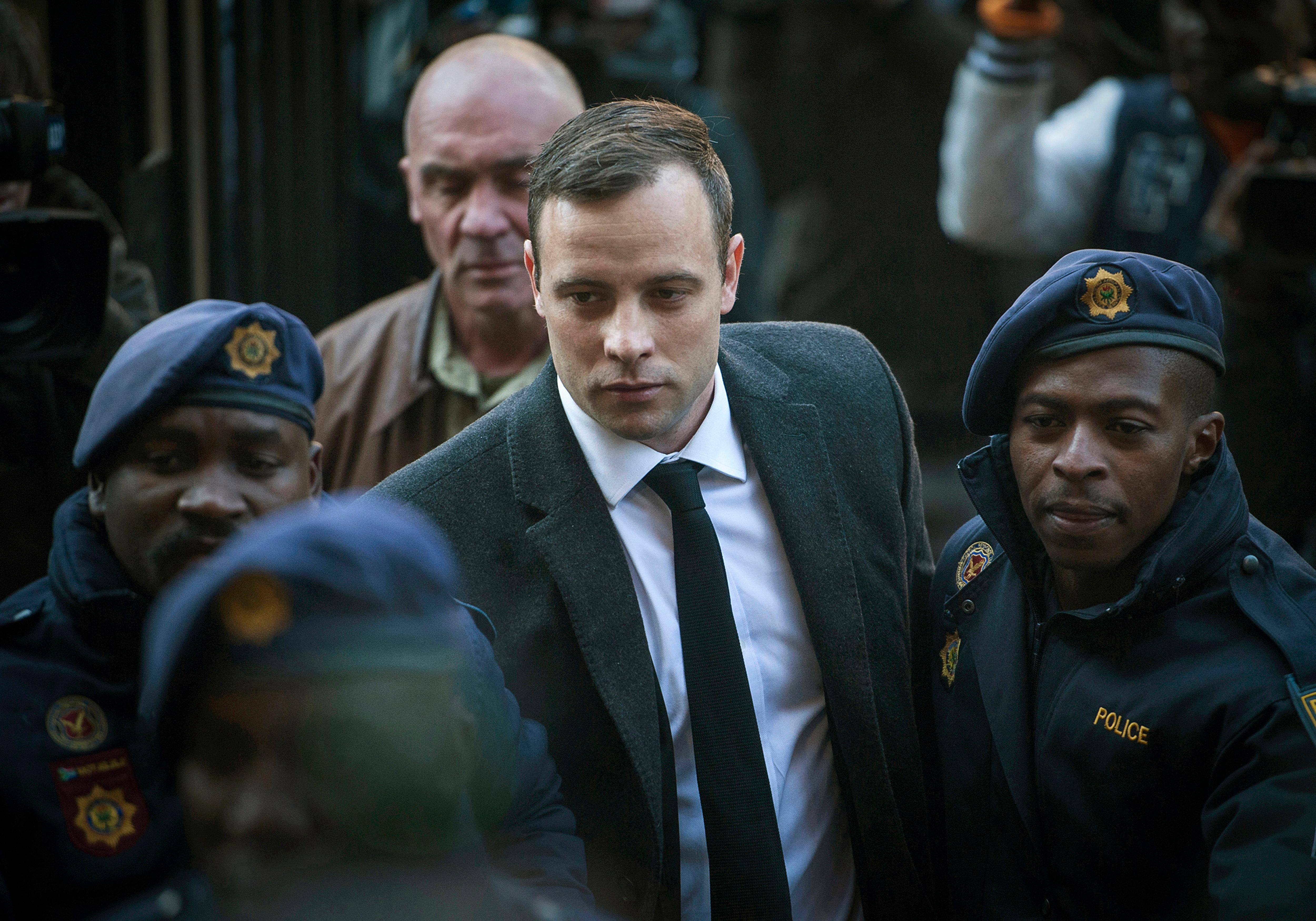 FILE - In this July 6, 2016, file photo, Oscar Pistorius, center, arrives at the High Court in Pretoria, South Africa, for a sentencing hearing for the murder of his girlfriend Reeva Steenkamp in his home on Valentine's Day 2013. (AP Photo/Shiraaz Mohamed, File)
