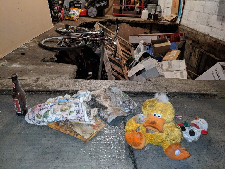 The Bush family has pulled out a child's stuffed ducky toy, a stuffed snowman, a beer bottle dated 1999, an envelope dated 2005 with a woman's name and out-of-state address that was empty, a Melaleuca catalog, and lots of garbage from a room discovered underneath their garage. (Photo courtesy Brittany Bush)<p></p>