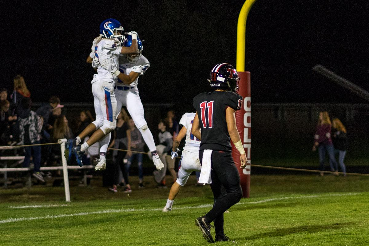 Churchill Lancers celebrate after scoring a touchdown. The Churchill Lancers defeated the Thurston Colts 40 - 35 at Thurston High School on Friday, September 29.