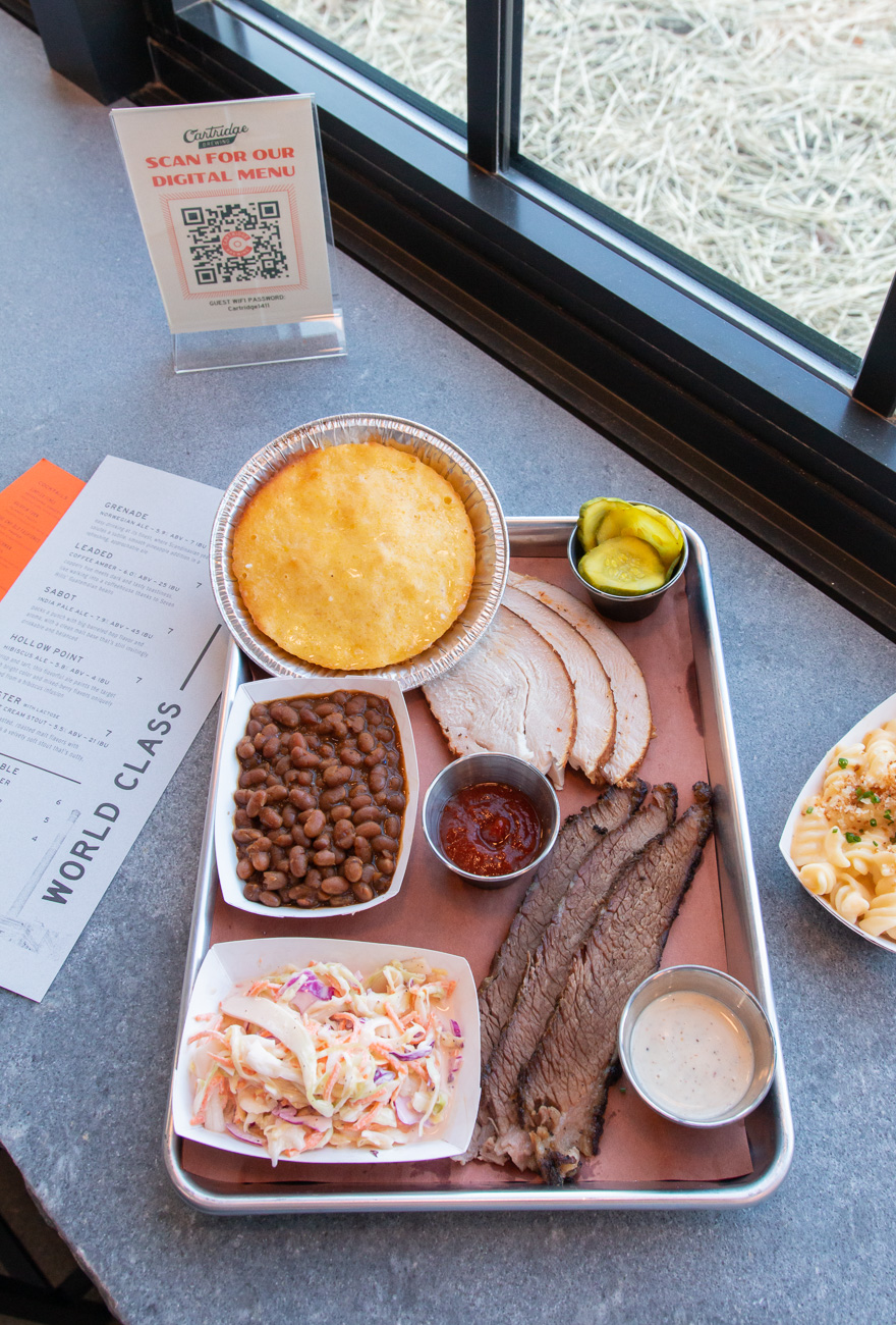 <p>Two-meat combo with smoked turkey and prime brisket, mac & cheese, cornbread, tricolor coleslaw, brown sugar baked beans, and house-made pickles, with house BBQ and Alabama BBQ sauces / Image: Elizabeth A. Lowry{&nbsp;}// Published: 11.25.20</p>