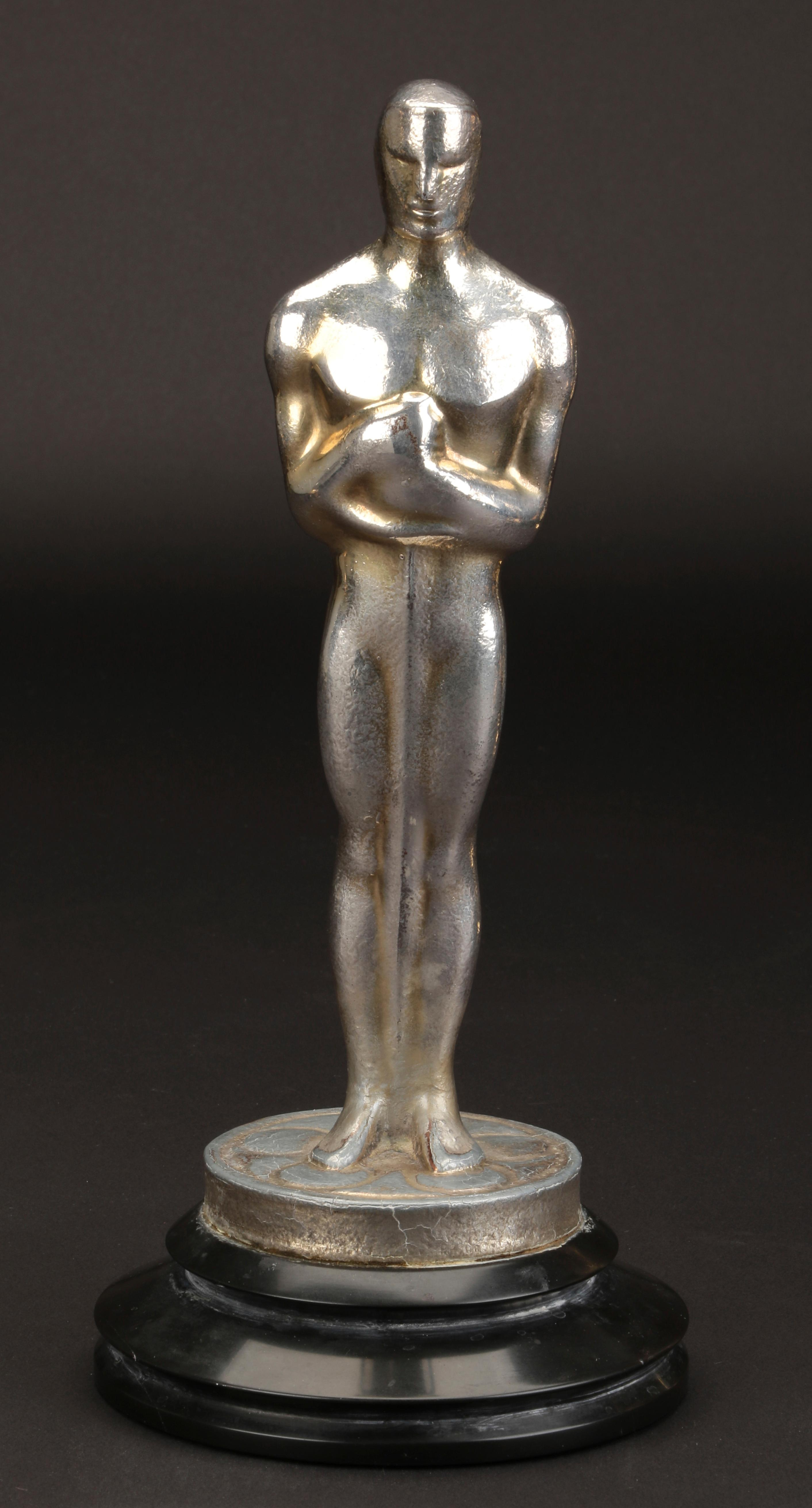 "FILE - This undated file image provided by Profiles in History shows Irving Thalberg's Academy Award for best picture for ""Mutiny on the Bounty."" The best picture statuette for 1935's ""Mutiny on the Bounty"" fetched $240,000., in a rare auction of Oscars that ended Friday, Dec. 14, 2018, in Los Angeles. (Lou Bustamante/Profiles in History via AP, File)"