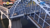 "Calvin ""rides"" the Market Street Bridge in downtown Chattanooga during its inspection"