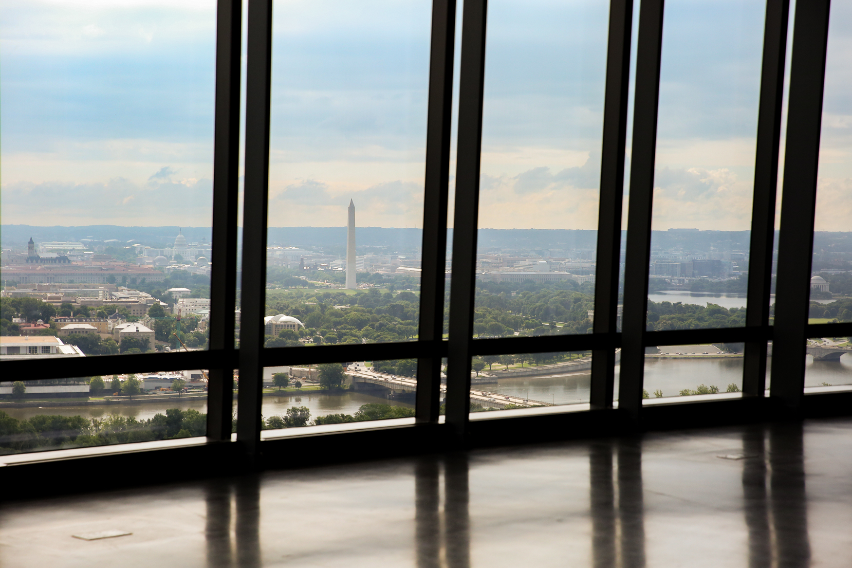 D.C. prizes its rooftop bars and pools, but nothing in The District can compare to the The Observation Deck at CEB Tower, which opens to the public today. The Observation Deck offers a panoramic look at D.C. and Northern Virginia, meaning visitors can catch a bird's eye-view of The Pentagon, the Potomac River and the National Mall. The Observation Deck is more than just a visual experience - it has a state-of-the art mini-museum that offers a glimpse into the history of what you're seeing outside the floor-to-ceiling windows using digital displays and holograms. Although those who are afraid of heights may be able to stomach the views from the enclosed 31st floor, the brave can head to the deck on the 32nd floor. Although the deck is surrounded by huge panes of glass, try not to look down and remember that you're standing 387 feet above the Rosslyn sidewalk below. The Observation Deck at CEB Tower is located at 1201 Wilson Blvd., Arlington, VA and adult tickets online go for $21. (Amanda Andrade-Rhoades/DC Refined)<br>