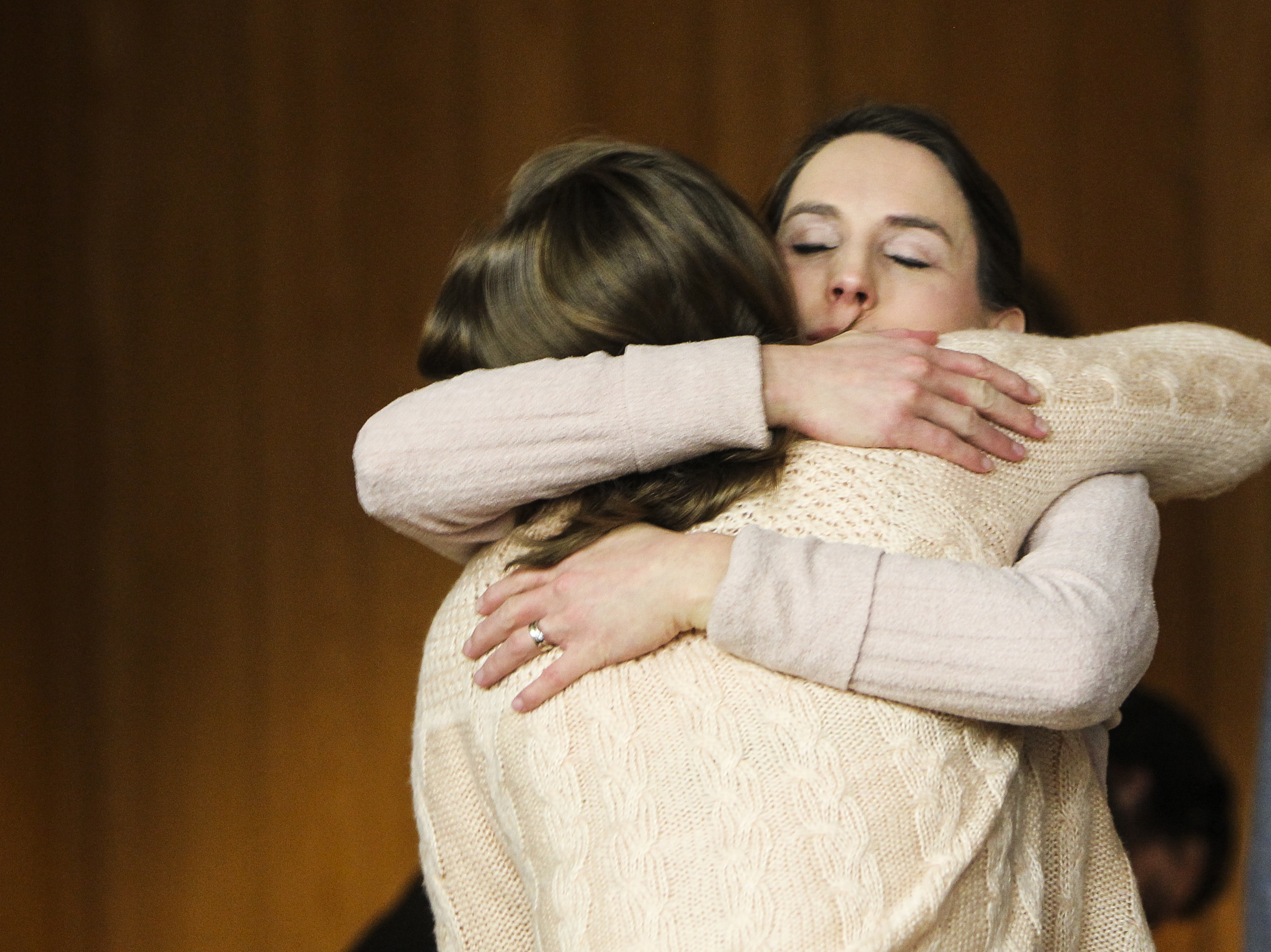 Rachael Denhollander hugs people Monday, Feb. 5, 2018, after the third and final day of sentencing of Larry Nassar in Eaton County Court in Charlotte, Mich., where Nassar was sentenced to between 40 and 125 years in prison on three counts of sexual assault.  (Matthew Dae Smith/Lansing State Journal via AP)