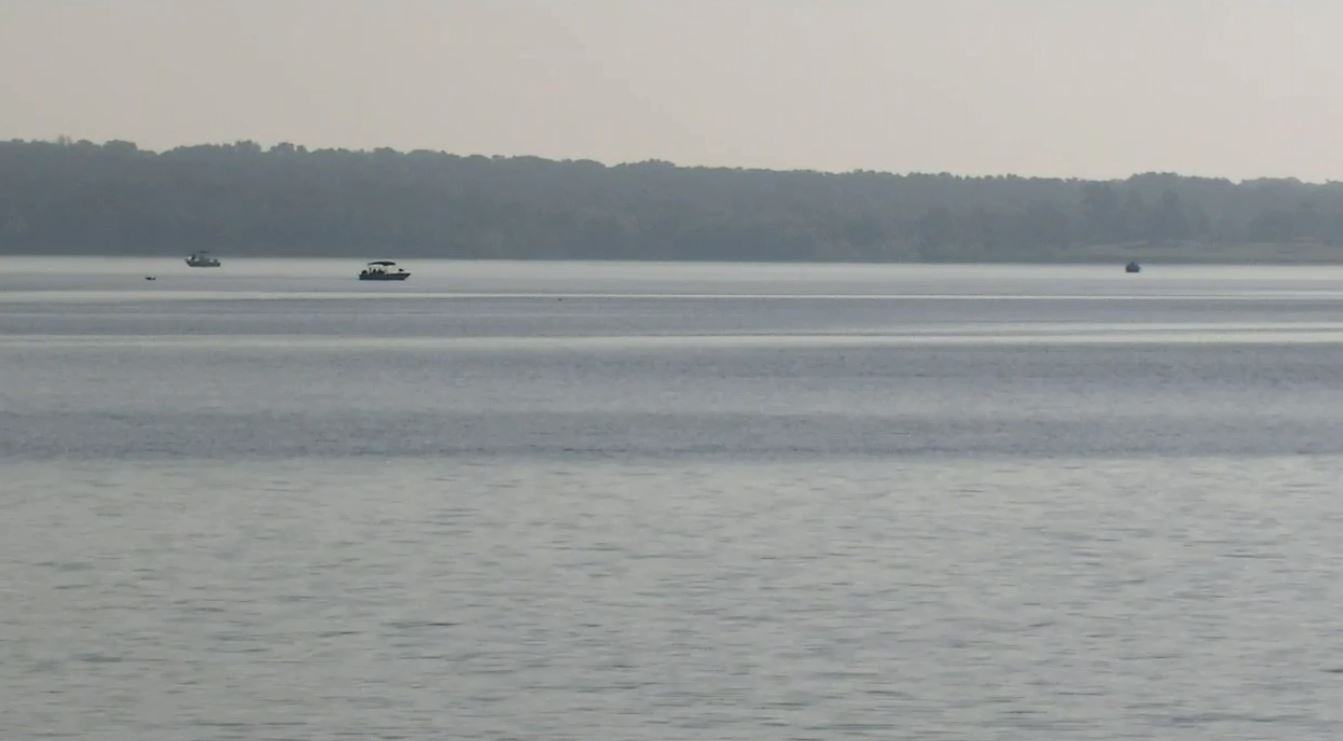 The Oklahoma Highway Patrol continues to search May 23 for a man's body following a crash along Lake Thunderbird. (KOKH/Eric Self)