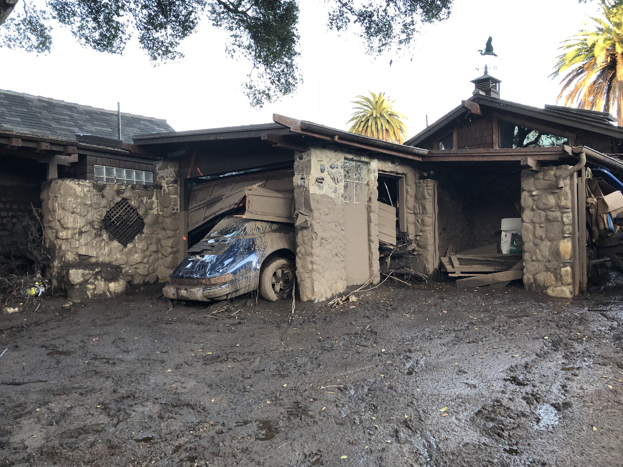 Deadly runoff of mud, boulders, and debris destroyed homes that lined Montecito Creek near East Valley Road. (Photo & Caption: Mike Eliason, Santa Barbara County Fire Dept.)
