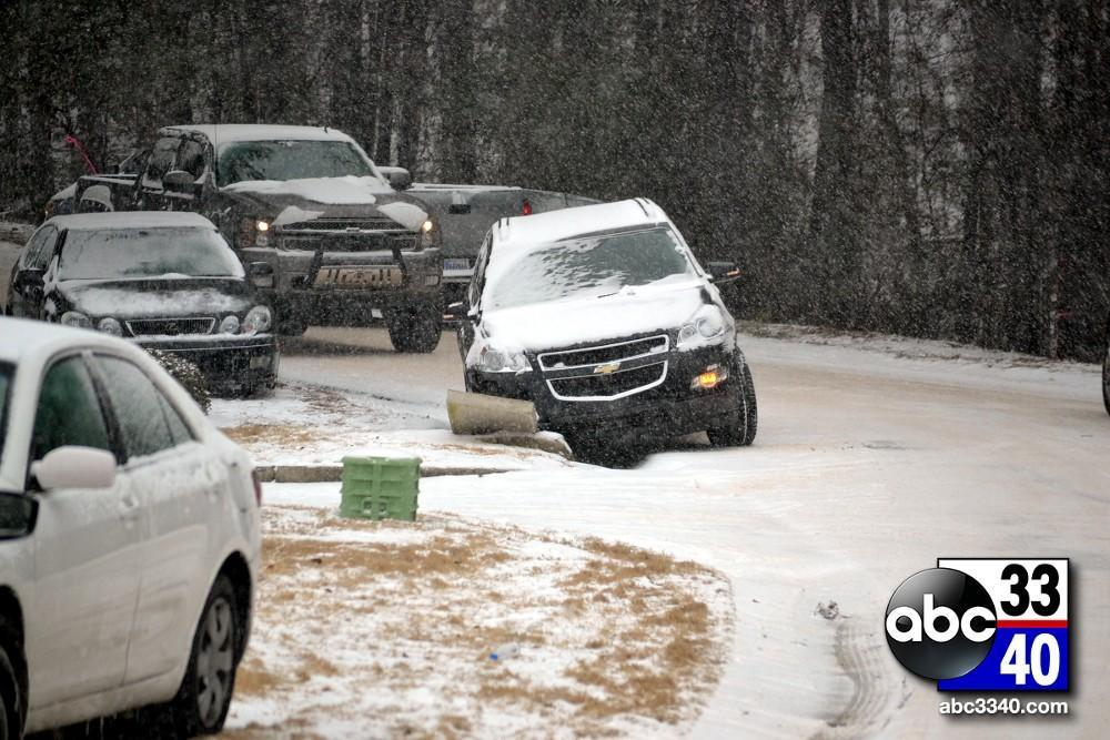 A wrecked vehicle on Data Drive in Hoover, Ala. during a winter storm, Tuesday, January 28, 2014.