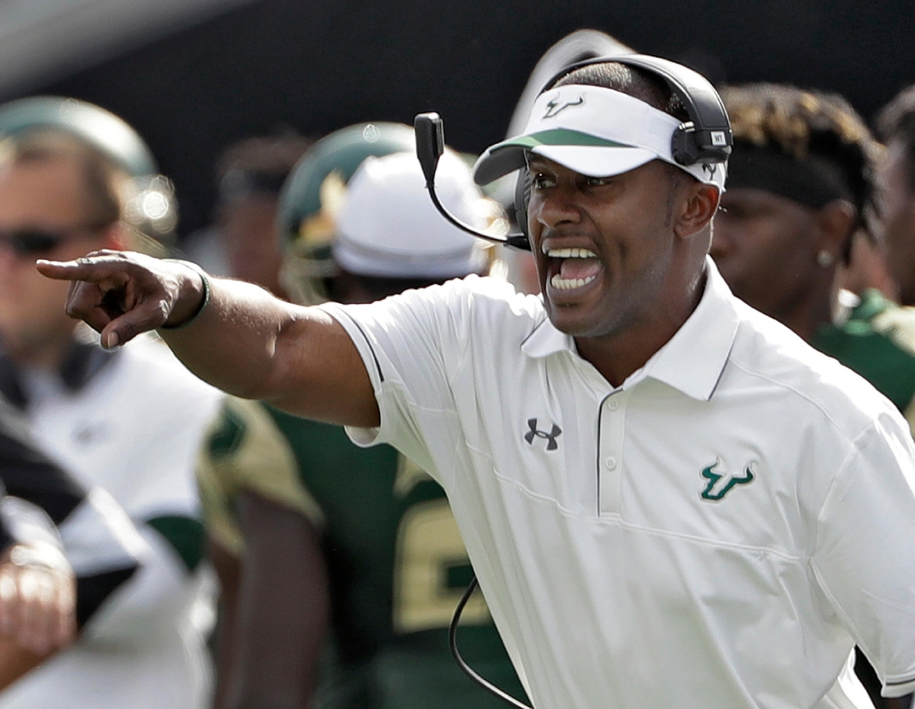 FILE - In this Nov. 26, 2016, file photo, South Florida head coach Willie Taggart shouts instructions to his team during the second half of an NCAA college football game against Central Florida, in Tampa, Fla. South Florida football coach Willie Taggart has informed the school that he is leaving to become the coach at Oregon, a person with direct knowledge of the situation tells The Associated Press. The person spoke on condition of anonymity because neither school was prepared to make an official announcement. (AP Photo/Chris O'Meara, File)