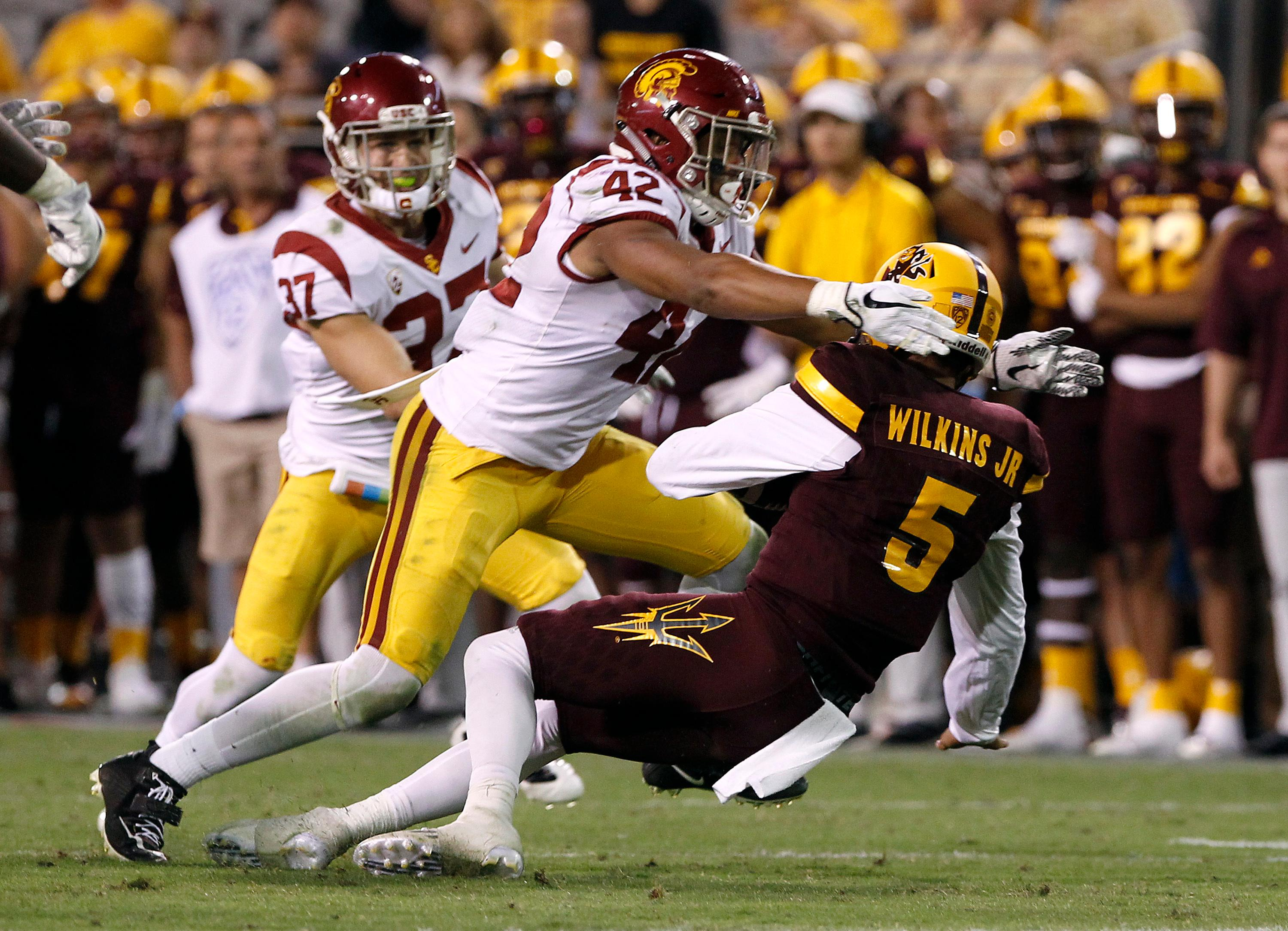 FILE - In this Oct. 28, 2017, file photo, Southern California linebacker Uchenna Nwosu (42) sacks Arizona State quarterback Manny Wilkins (5) during the second half of an NCAA college football game, in Tempe, Ariz. Nwosu was selected to the AP All-Conference Pac-12 team announced Thursday, Dec. 7, 2017. (AP Photo/Ralph Freso, File)