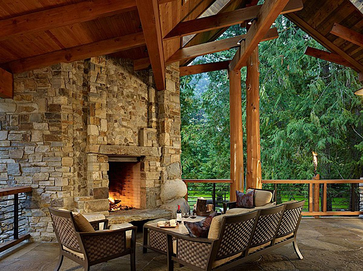 ThisNorthwest Rustic Garden> in Carnation, WA has a covered outdoor living space with fireplace, natural stream water feature and spa. It was completed by Darwin Webb Landscape Architects, P.S. and the project cost was $250K.   (Image: Northwest Rustic Garden / Porch.com)