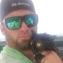 Charter boat captain rescues cat tossed off bridge